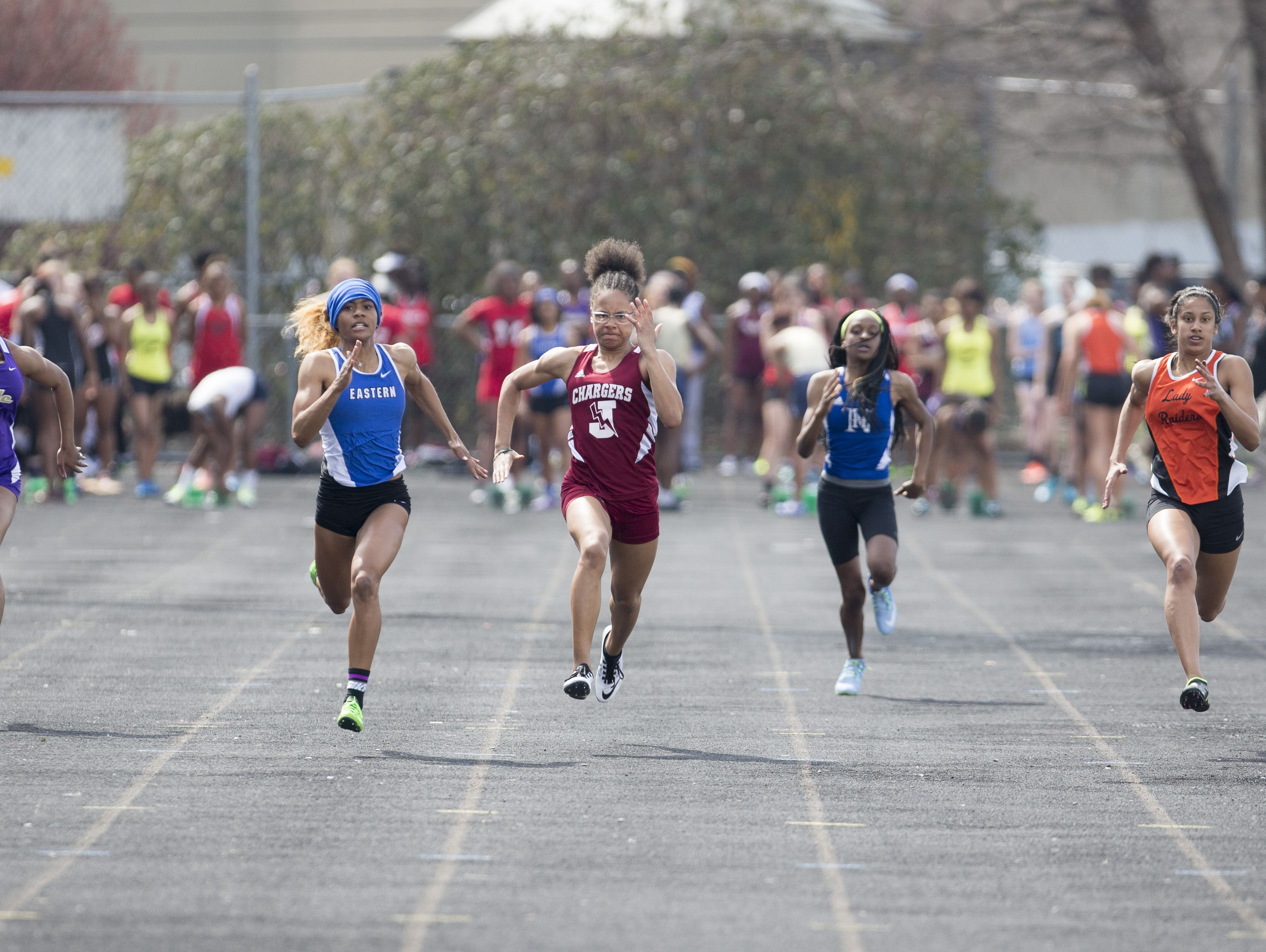 Participants compete in the Girl's 100 Meter Dash during the Lenny Lyles Invitational Track meet at Louisville Central High School.