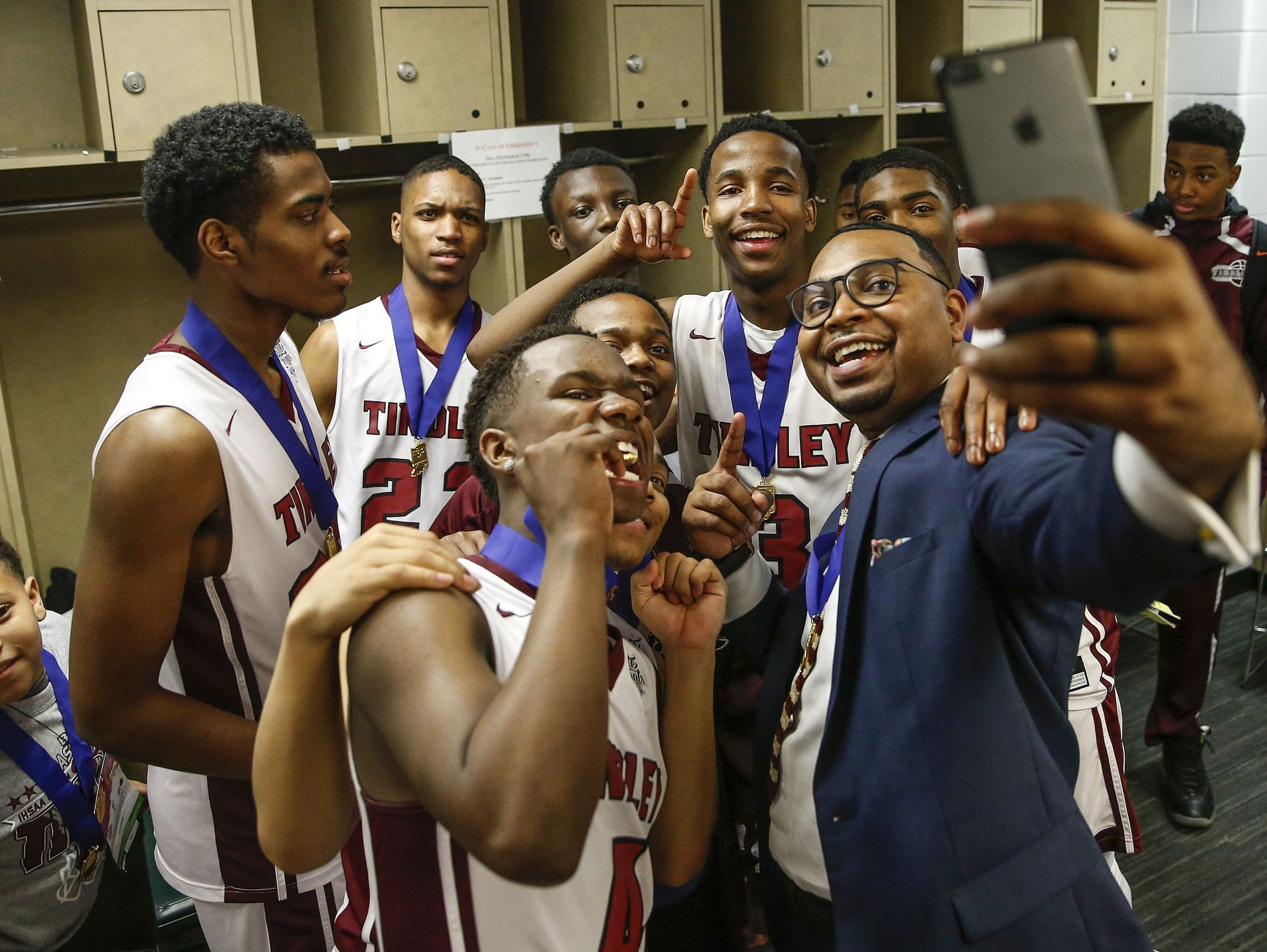 The Tindley Tigers take a selfie in the locker room after winning the IHSAA Class A state championship trophy game 51-49 over the Lafayette Central Catholic Knights at Bankers Life Fieldhouse in Indianapolis on Saturday, March 25, 2017.