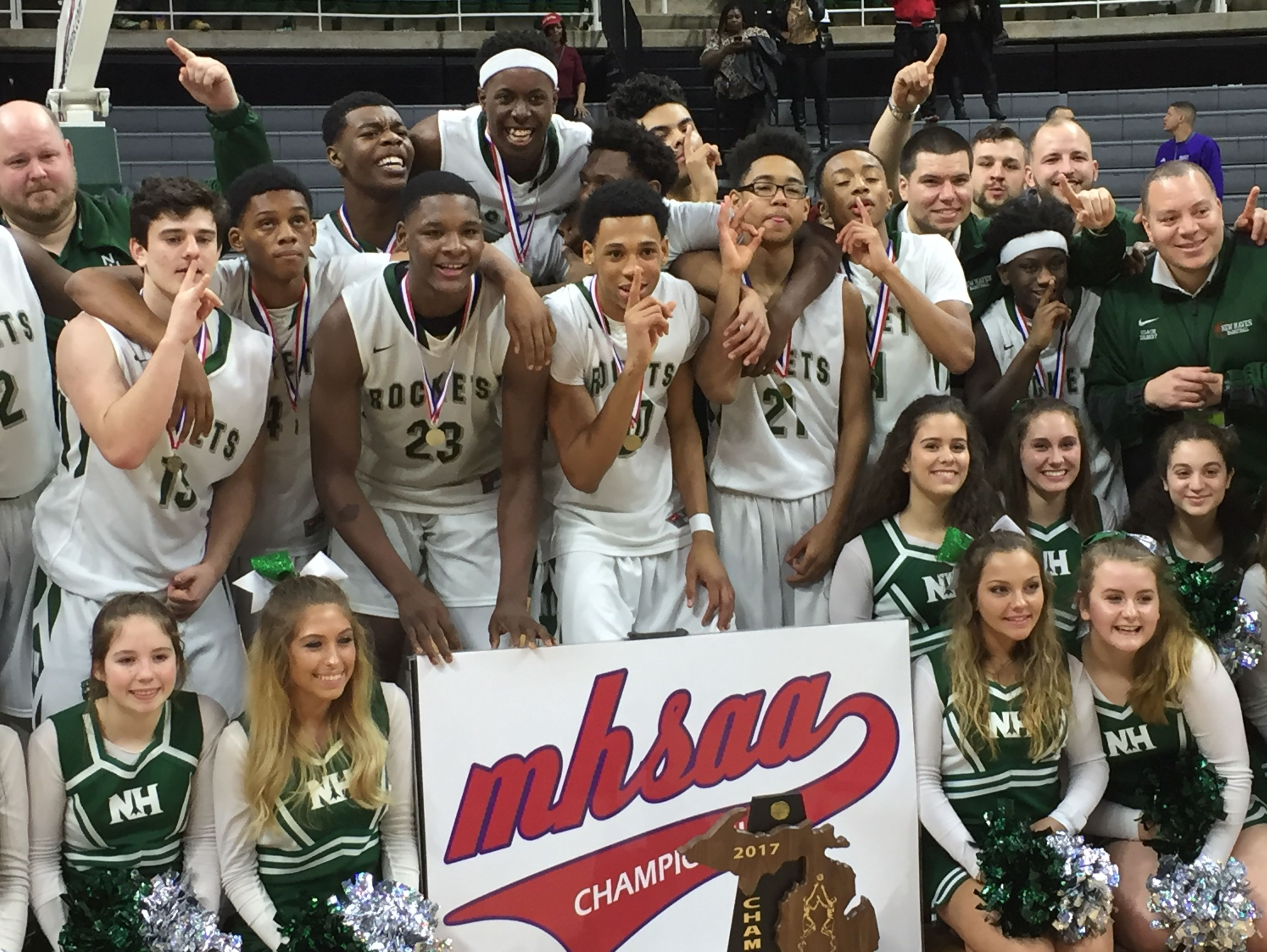New Haven celebrates its Class C boys basketball state championship Saturday at Breslin Center.