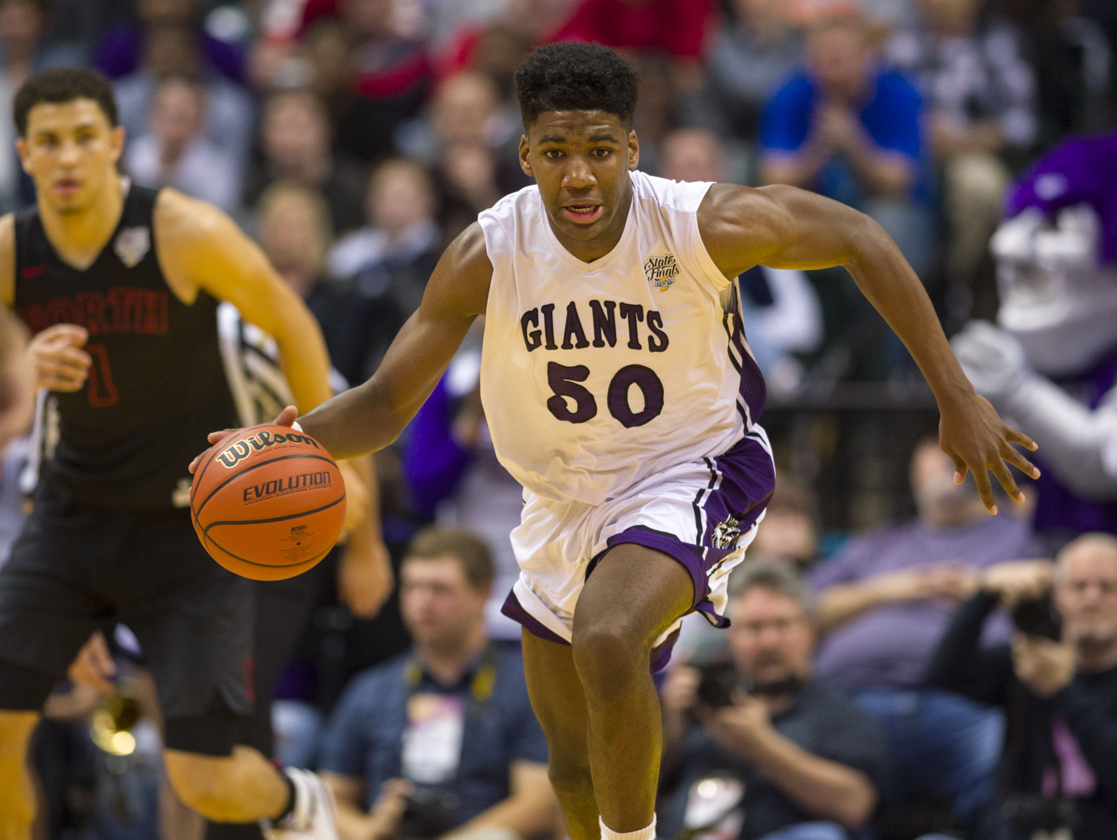 Ben Davis High School junior Aaron Henry (50) races the ball up court during the first half of the IHSAA 2017 Class 4A State Championship Game at Banker's Life Fieldhouse in Indianapolis, Saturday, March 25, 2017.