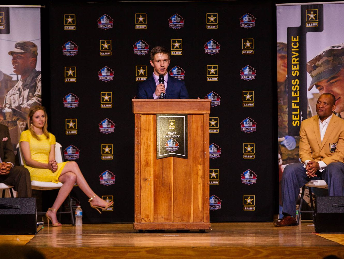 Cabool High School senior Logan Miller (center) addresses the student body during an assembly in his honor featuring Pro Football Hall-of-Famer Aeneas Williams (right)