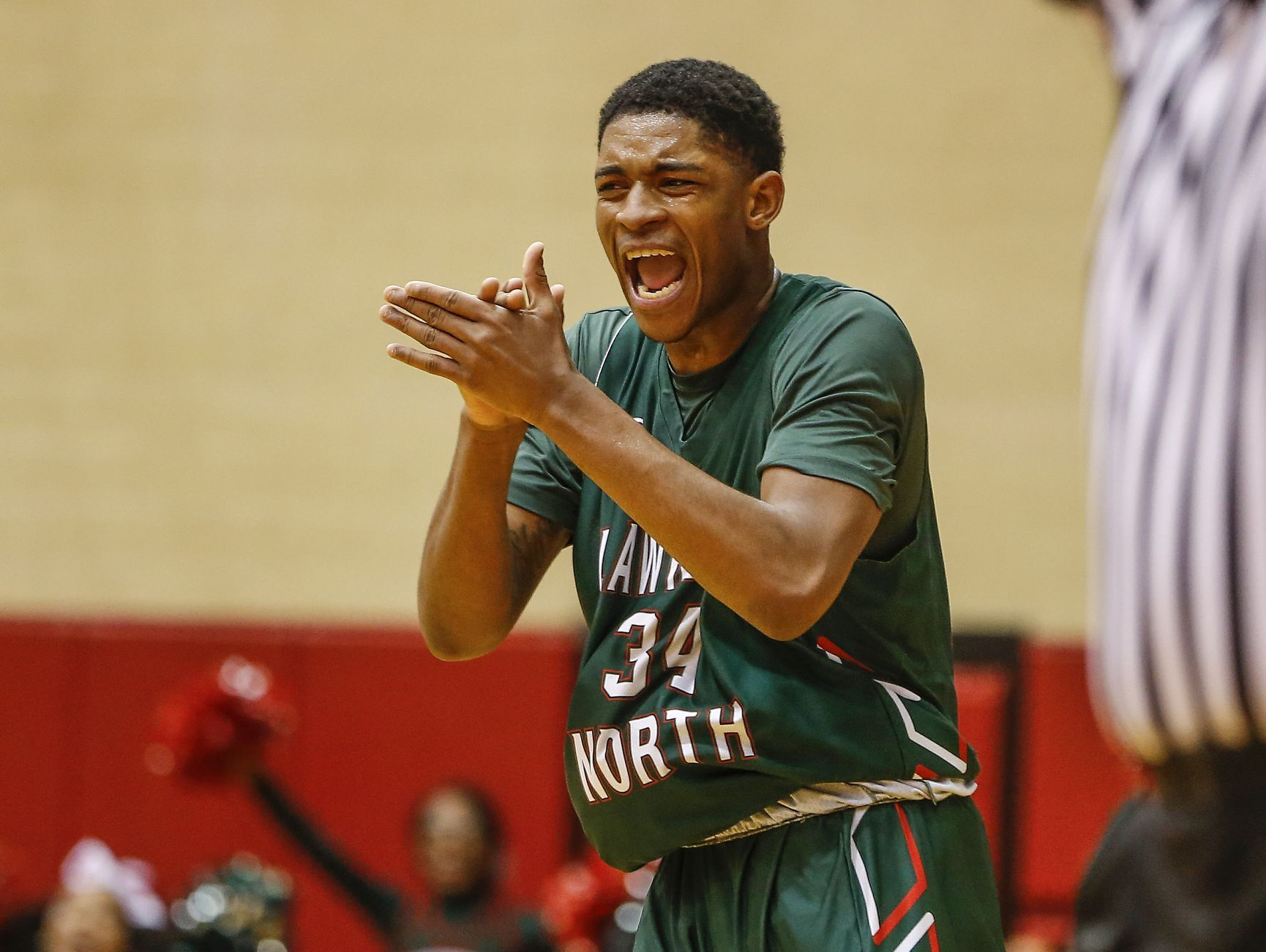 Lawrence North Wildcats Kevin Easley (34) celebrates after connecting on a three-point shot against the North Central Panthers during their IHSAA 4A sectional final basketball game at North Central High School on Saturday, March 4, 2017.