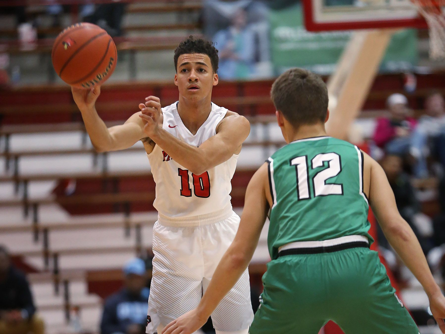 Park Tudor's #10 Kobe Webster passes past Cloverdale's #12 Nick Winders during the Cloverdale vs Park Tudor basketball game of the Tip Off Classic at Southport Fieldhouse, Saturday, December 10, 2016. Park Tudor won the game 74-63.