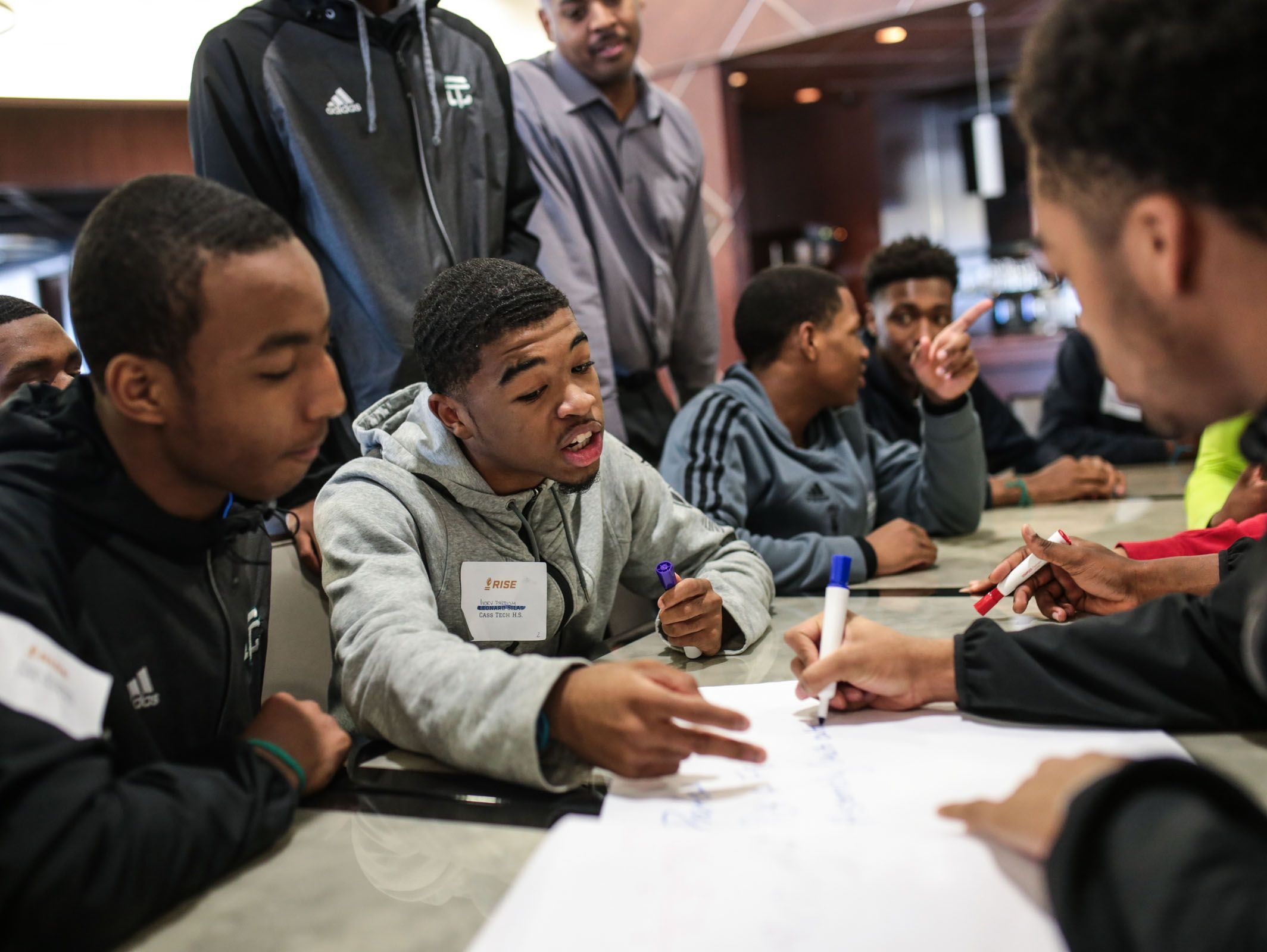 Case Tech High School student Ivory Parrish (center) gives his ideas during the RISE (Ross Initiative in Sports for Equality) event at The Palace of Auburn Hills on Wednesday March 29, 2017.