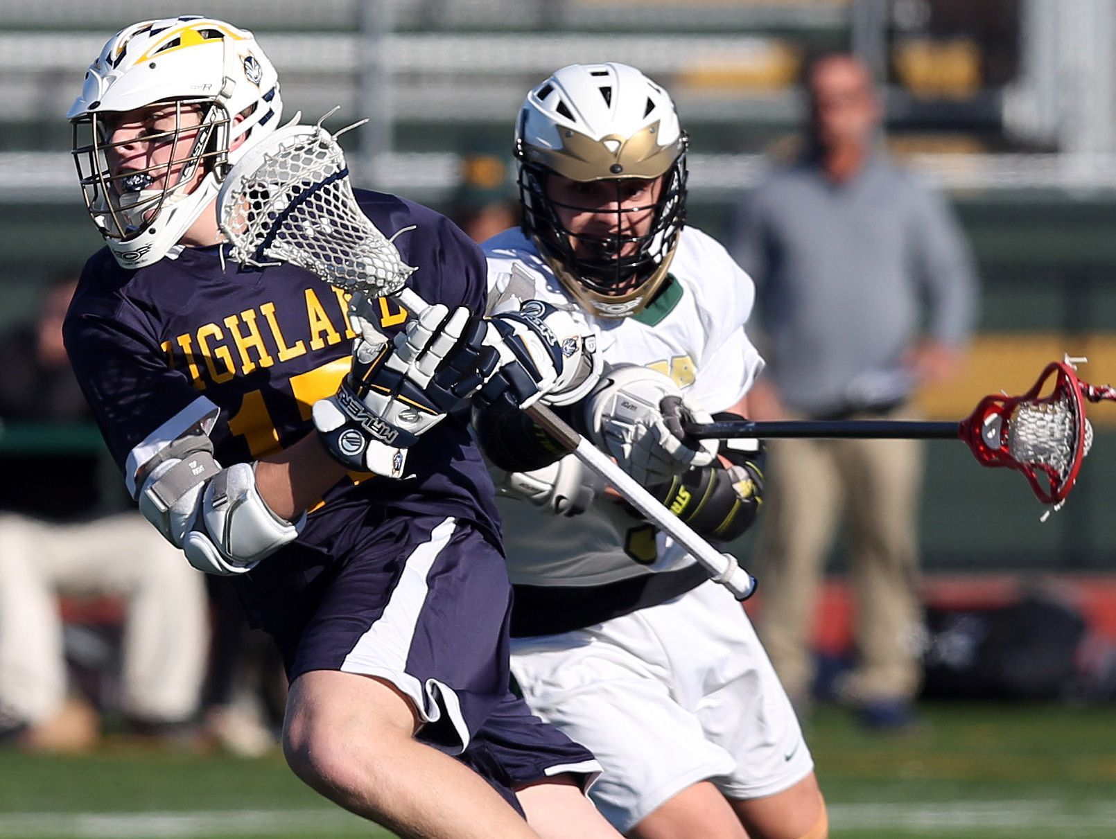 Highland's Jesse Weaver (17) turns the corner on FDR's Kyle Mackin (9) during boys lacrosse action at Franklin D. Roosevelt High School in Staatsburgh March 18, 2017.