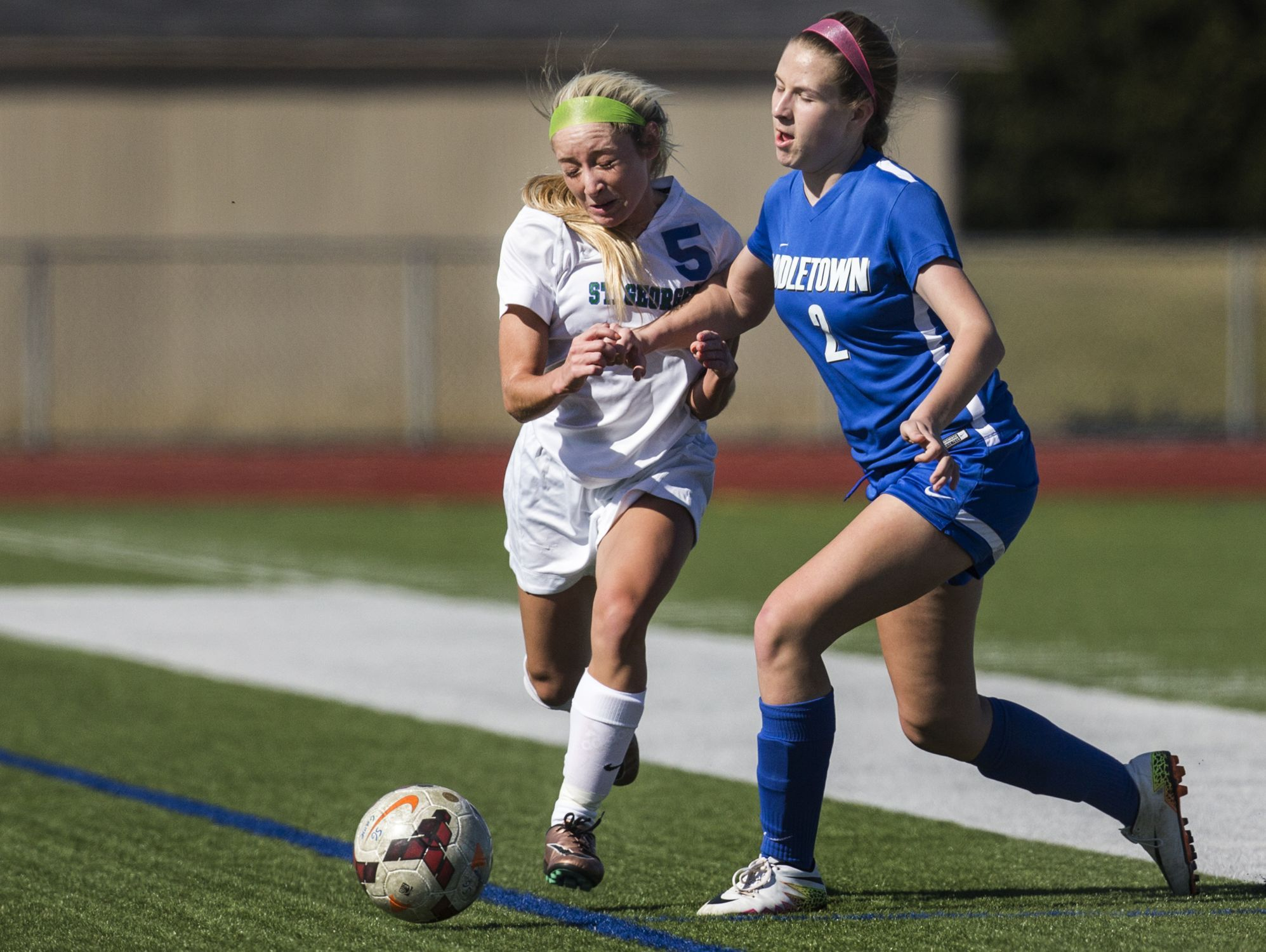 Middletown's Abigail Vetter (right) collides with St. Georges Daniella DeSouza as they chase down the ball in the first half of Middletown's 4-0 win over St. Georges at St. Georges Technical High School in Middletown on Wednesday afternoon.