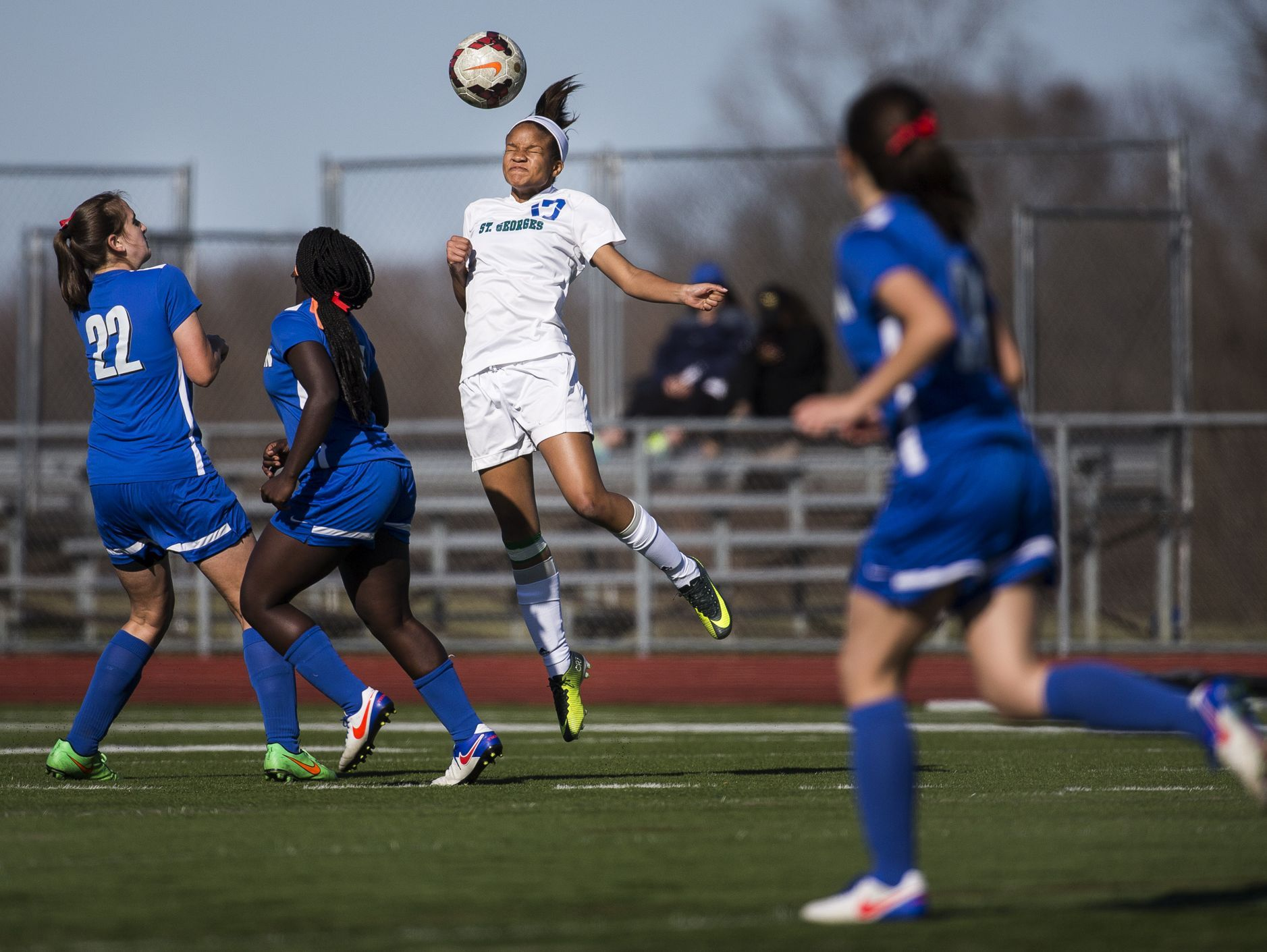 St. Georges' Paige-Marie Davis heads the ball over a pair of Middletown players in the second half of Middletown's 4-0 win over St. Georges at St. Georges Technical High School in Middletown on Wednesday afternoon.