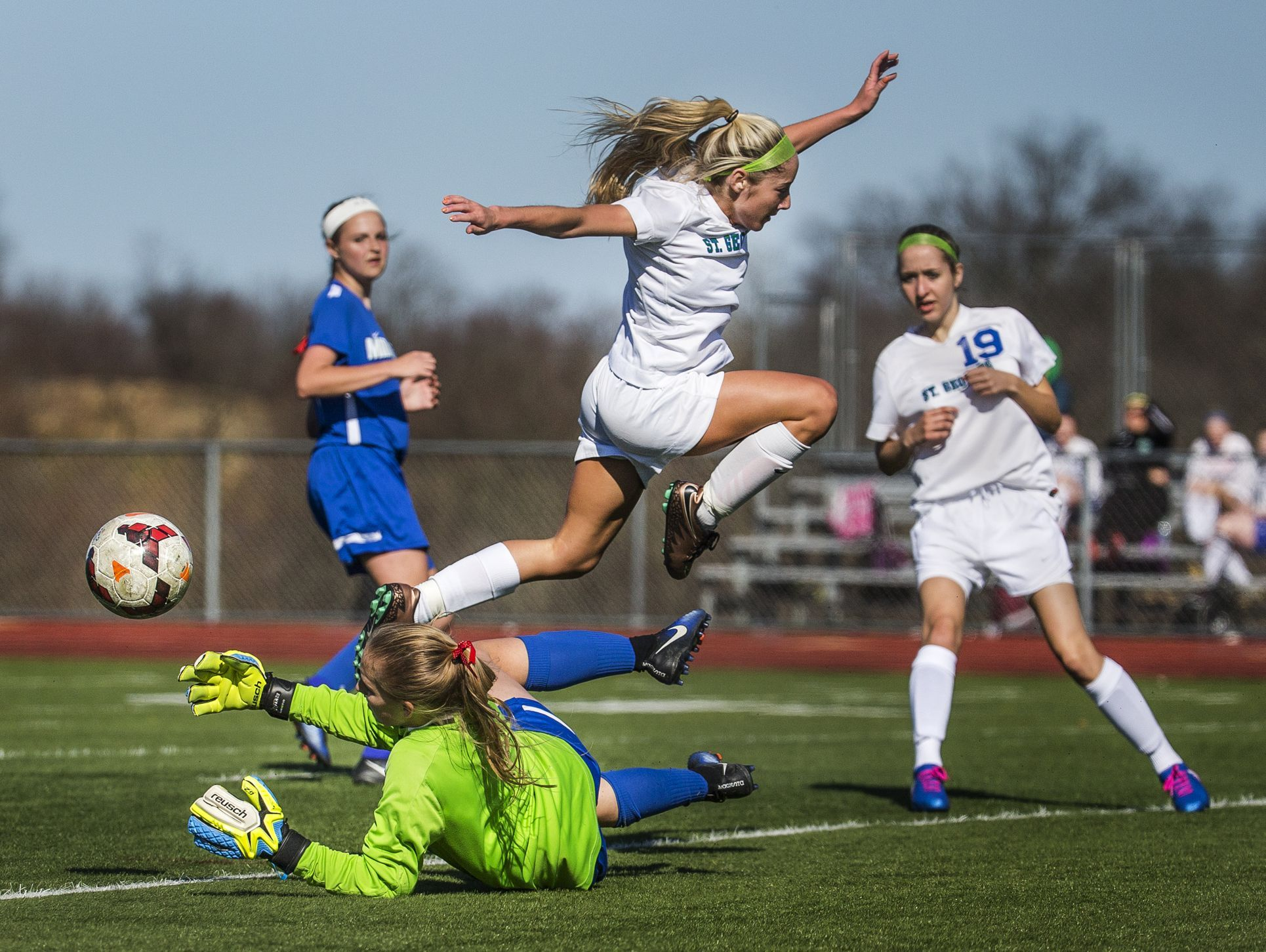 St. Georges' Daniella DeSouza leaps over Middletown keeper Taylor Wolf in the first half of Middletown's 4-0 win over St. Georges at St. Georges Technical High School in Middletown on Wednesday afternoon.
