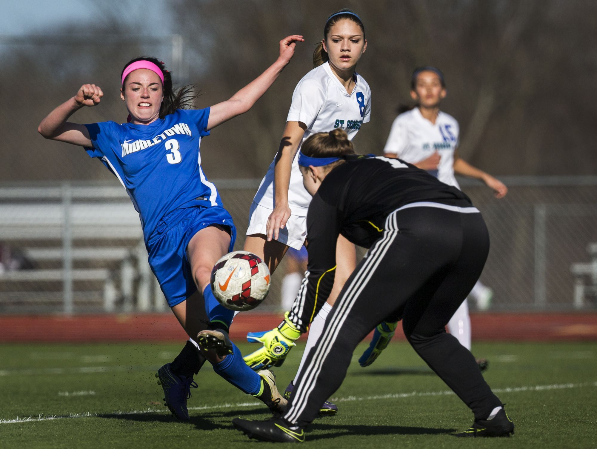 St. Georges keeper Morgan Mitchell takes the ball off of the foot of Middletown's Rachel Finelli (left) in the second half of Middletown's 4-0 win over St. Georges at St. Georges Technical High School in Middletown on Wednesday afternoon.