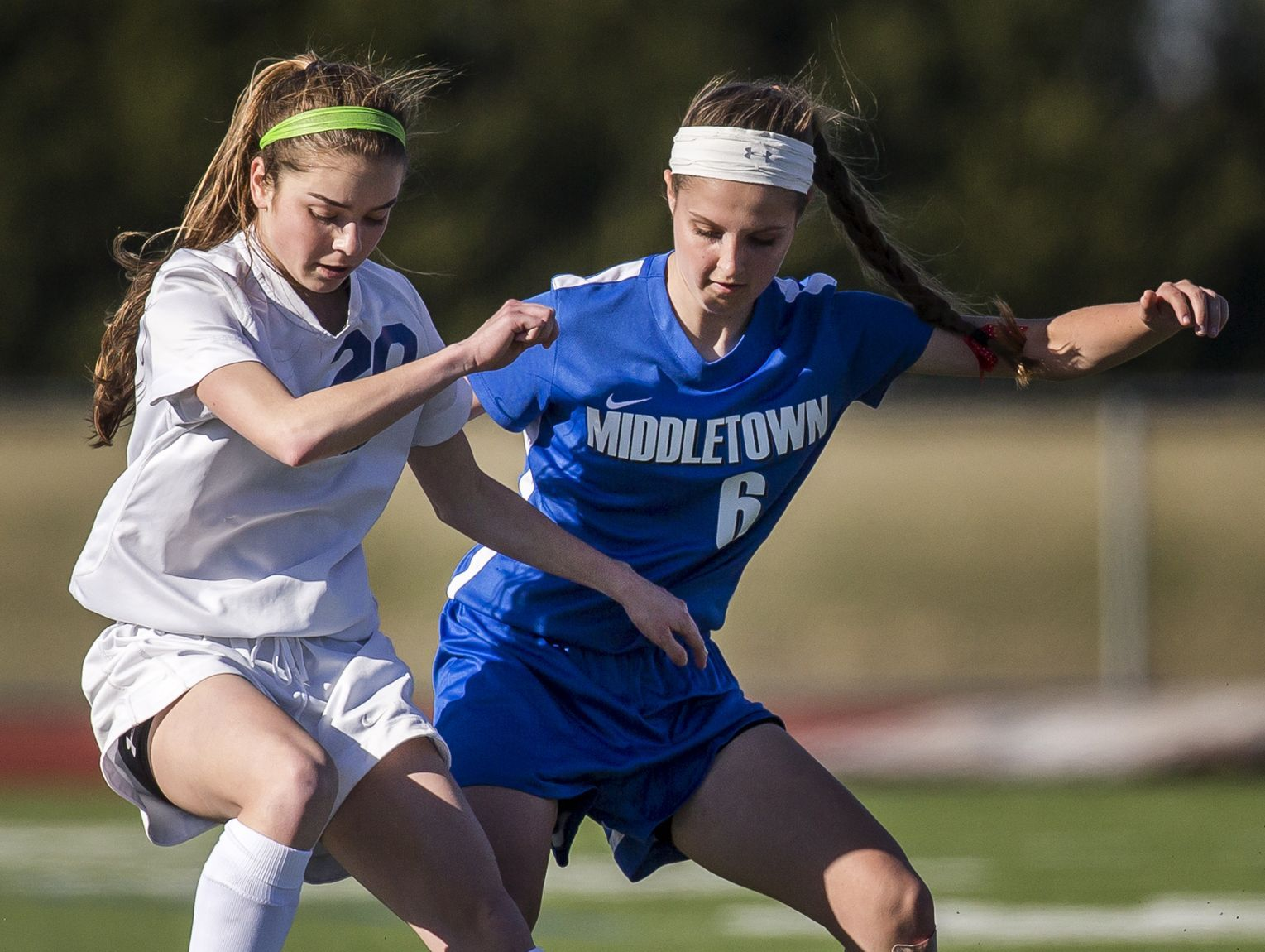 St. Georges' Sarah Lintz (left) and Middletown's Hayley Rohrer (right) fight for the ball in the second half of Middletown's 4-0 win over St. Georges at St. Georges Technical High School in Middletown on Wednesday afternoon.
