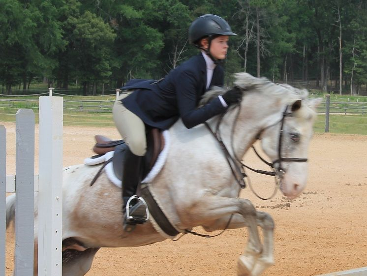 Bossier City's Casey Tonnies competes in an equestrian event.