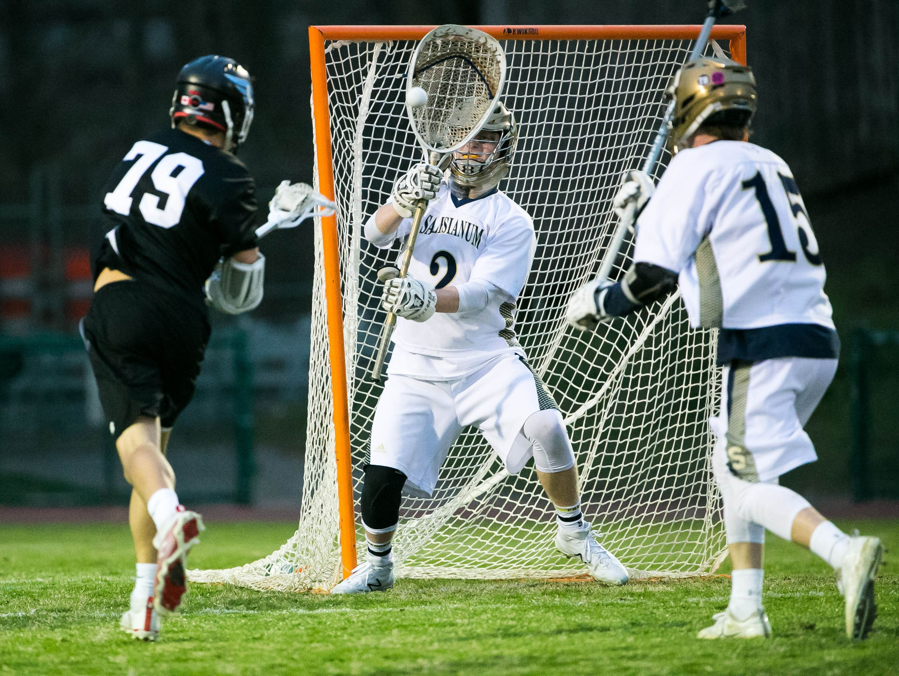 Josh Zawada of Hill Academy fires a shot at Salesianum goalie Brady Emmi for the first point of the game.