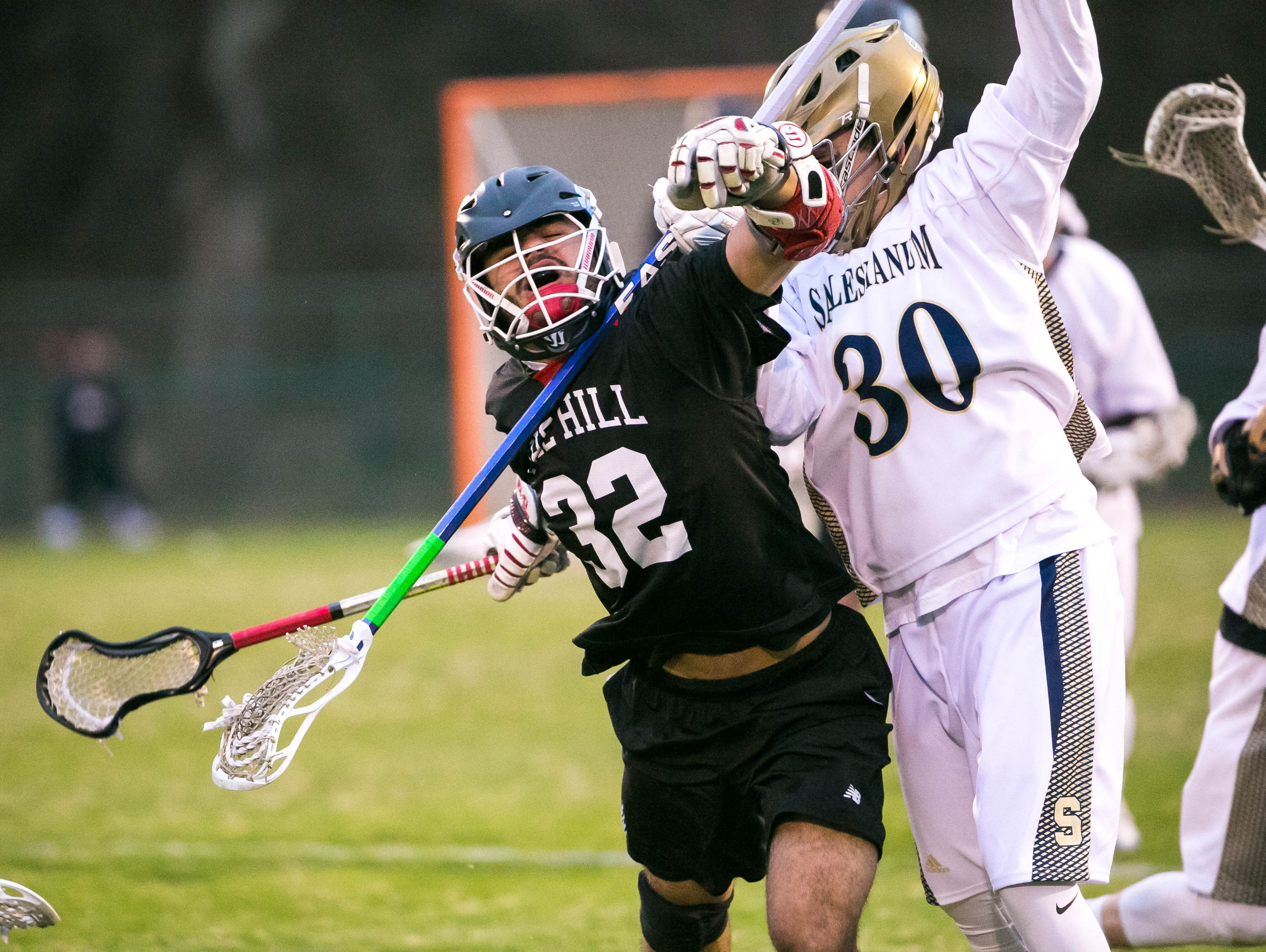 Justin Inacio of Hill Academy battles with James Blazkow of Salesianum in the first quarter at Baynard Stadium.