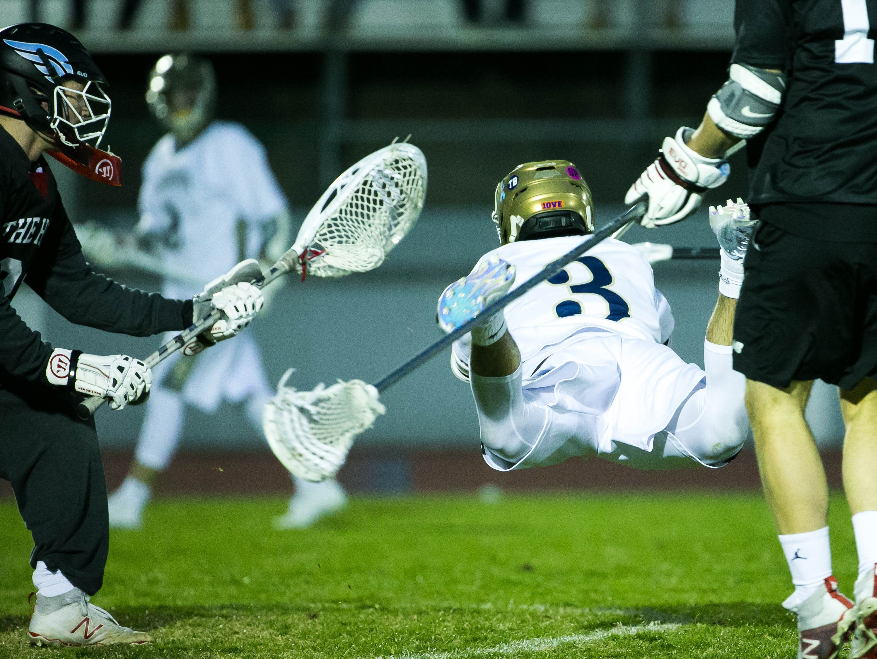 Michael Drake of Salesianum dives for the ball which flies by.