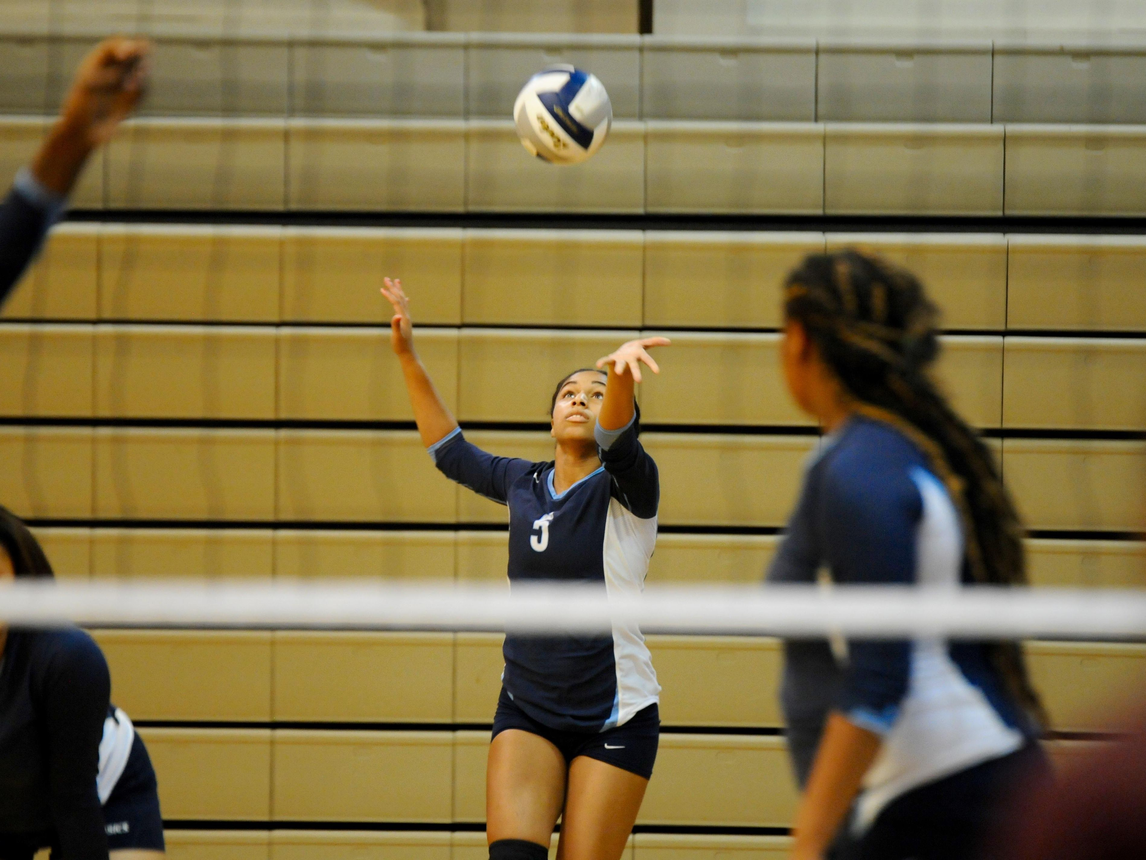 Westminster's Neilee Newton serves during the recent tournament at Ascension Episcopal School.