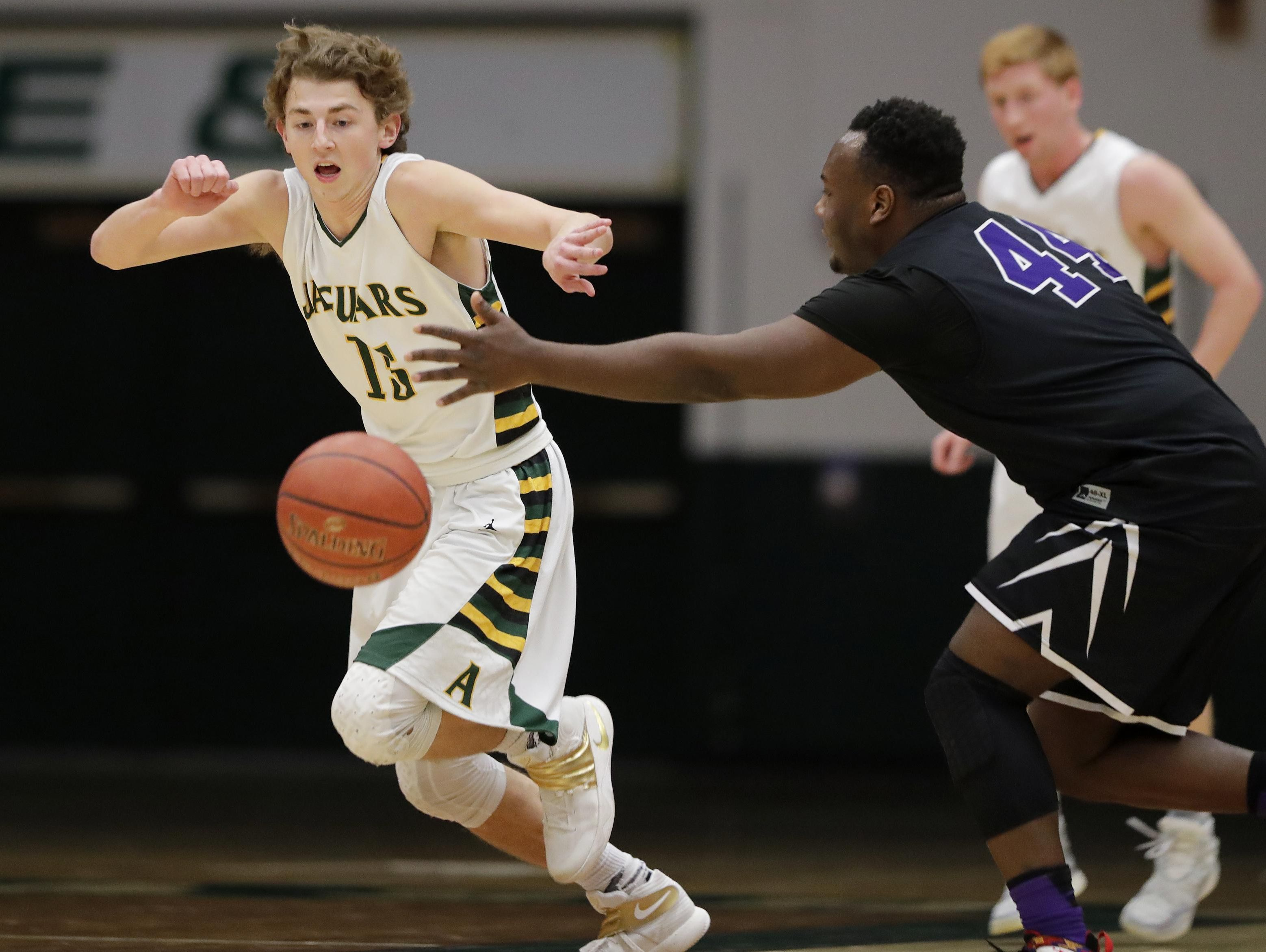 Ashwaubenon's Ben Wittig (15) steals the ball against Green Bay West's Anthony King (44) in a WIAA Division 2 regional quarterfinal at Ashwaubenon on Tuesday. See more photos from the game at greenbaypressgazette.com.