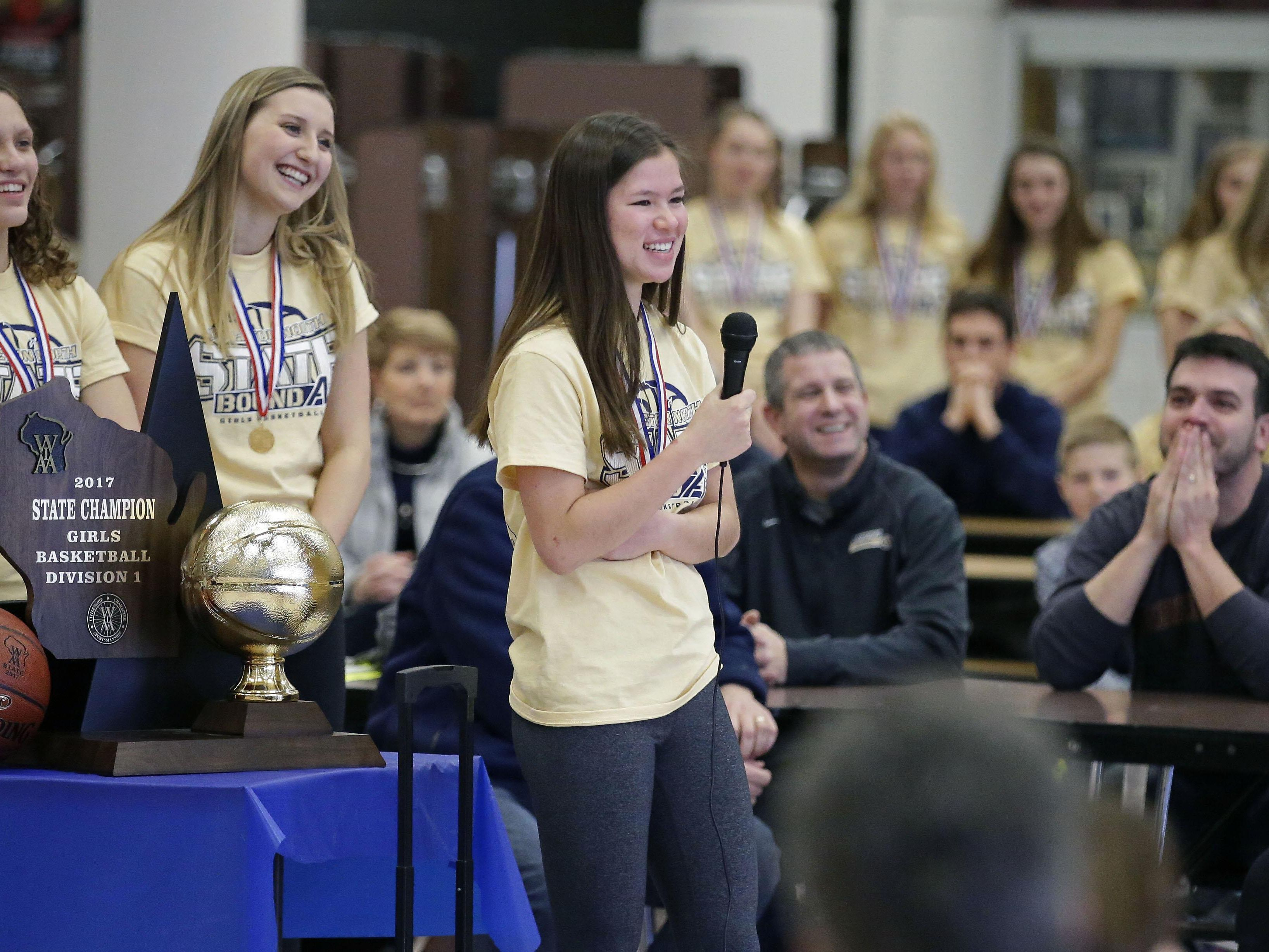 Appleton North players Callie Pohlmann, left, Sydney Levy and Kari Brekke talk with fans as the school holds a state championship celebration for the girls' basketball and cheer teams Sunday.