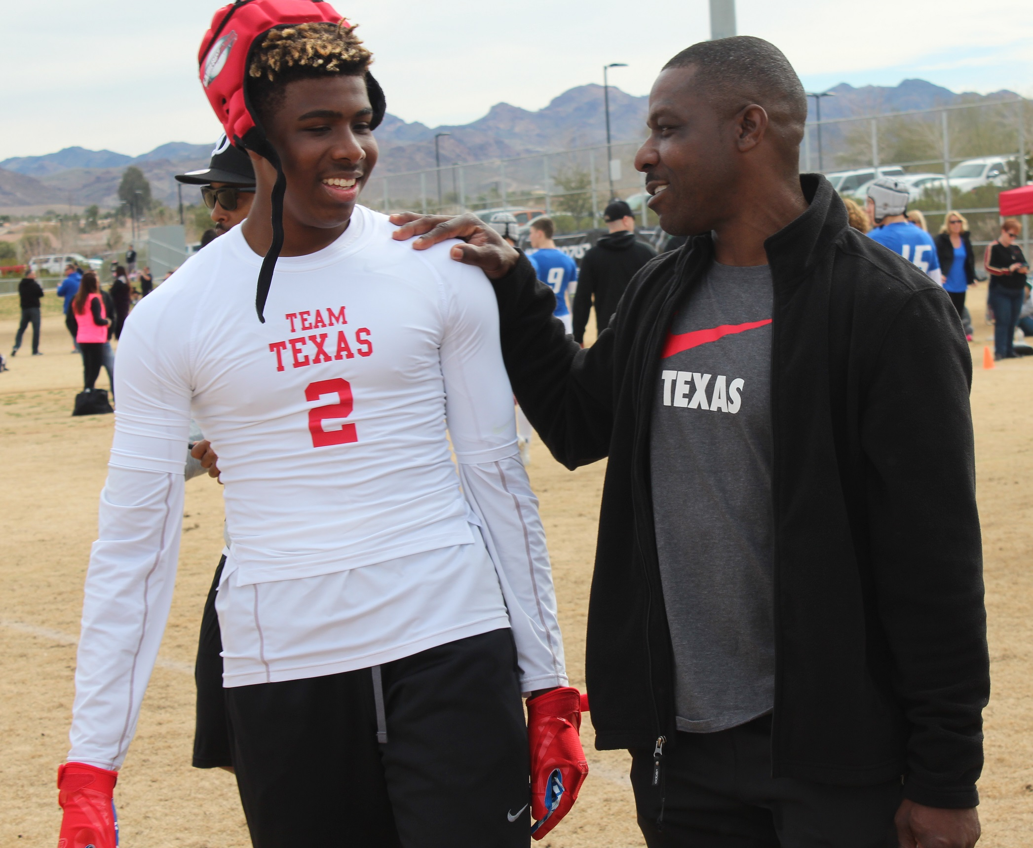 RJ Mickens and his father, Ray, share a moment last weekend during the Pylon 7on7 Las Vegas National Championships. RJ Mickens is a freshman at Southlake, Texas' Carroll High, where he had three interceptions and earned first-team all-district honors. (W.G. Ramirez)