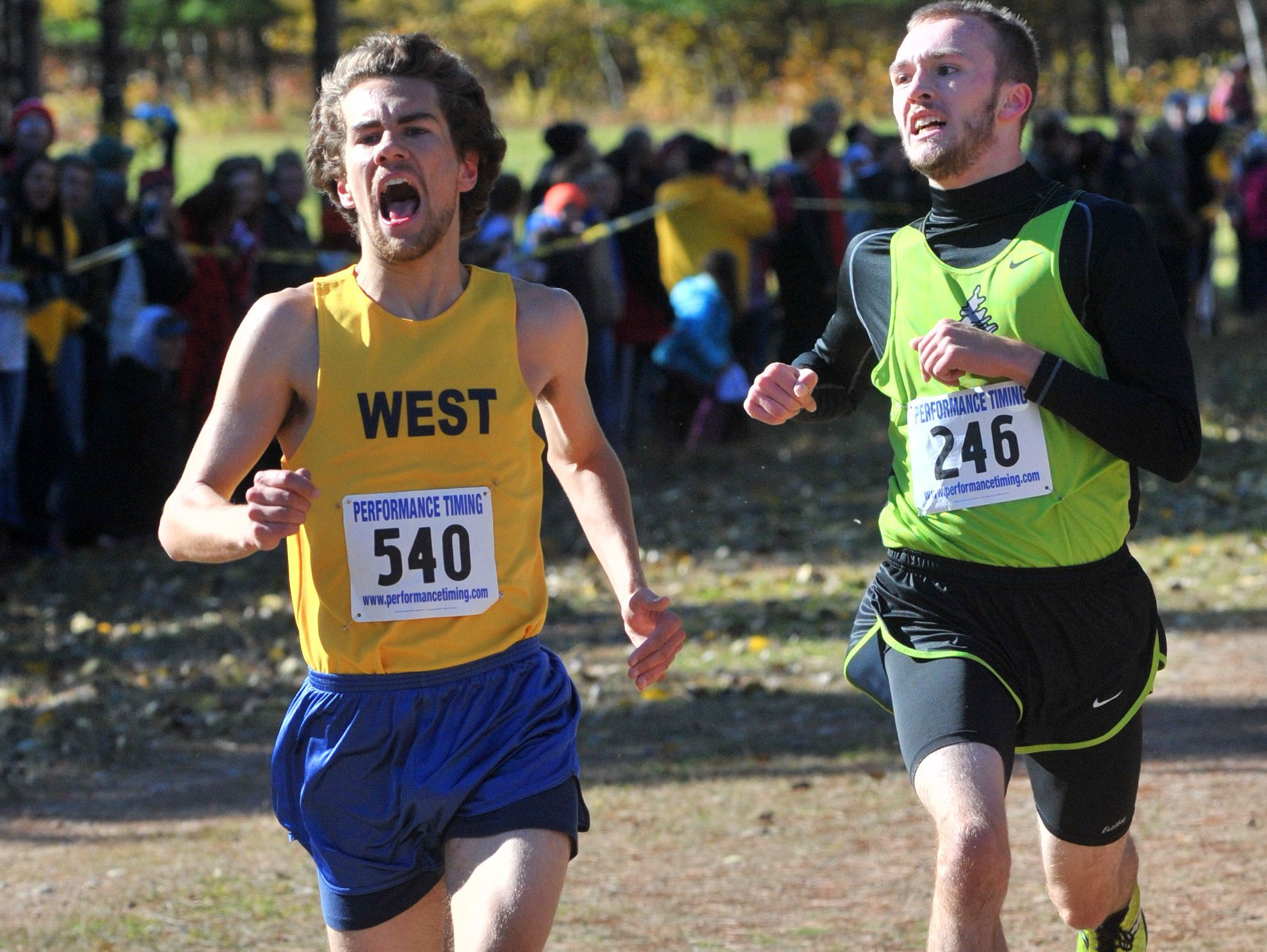 West's Joshua Kurth, left, finished seventh and follow by Everest's Aaron Carr on Wisconsin Valley Conference boys varsity cross country meet Saturday, Oct. 18, 2014, at Nine Mile Recreation Area in Wausau.
