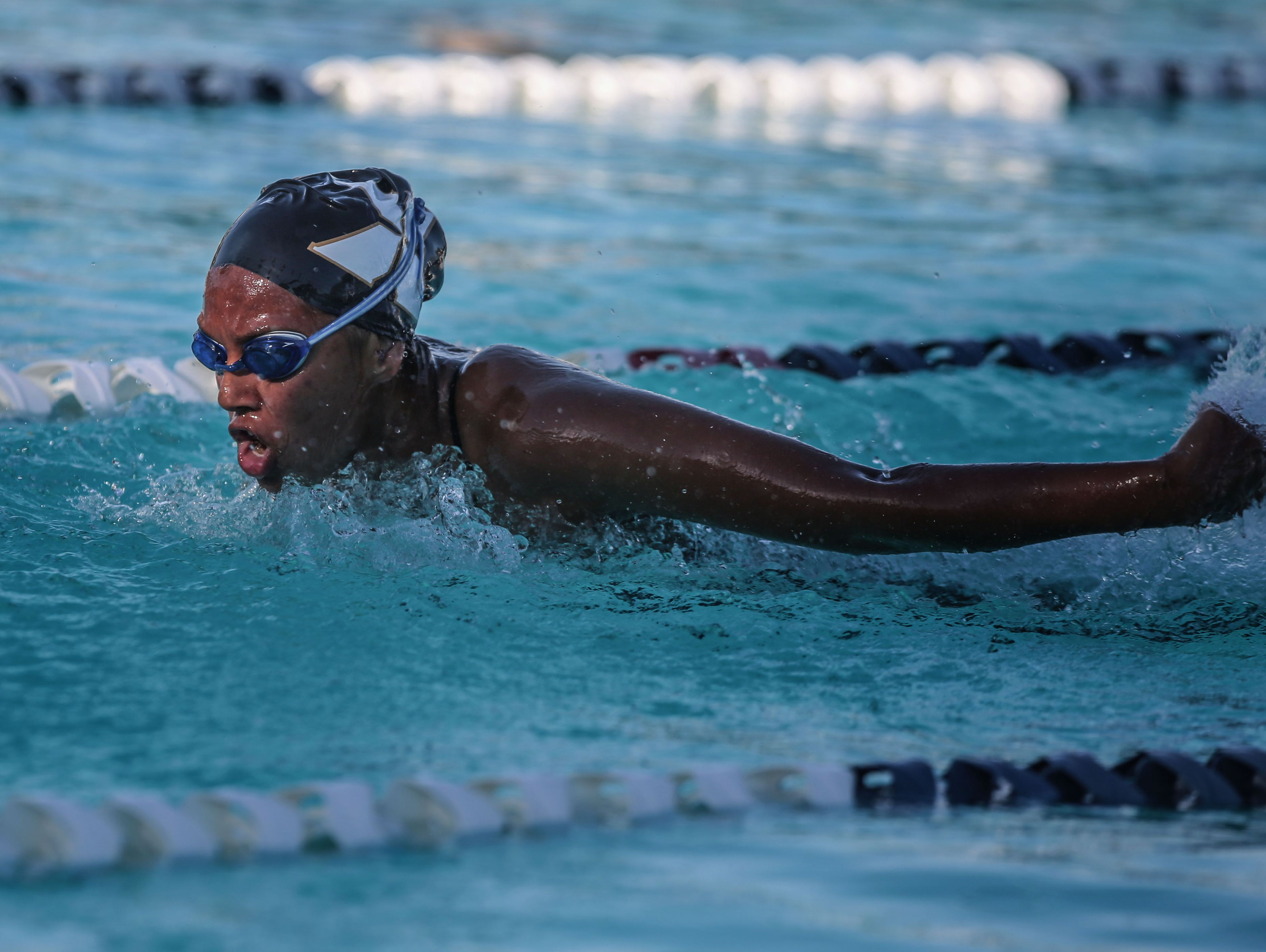 Saints' Jackie Cordero wins the girls 100 yard butterfly race during a swim meet between La Quinta and Xavier College Prep on Thursday, March 30, 2017 at Palm Desert Aquatic Center.