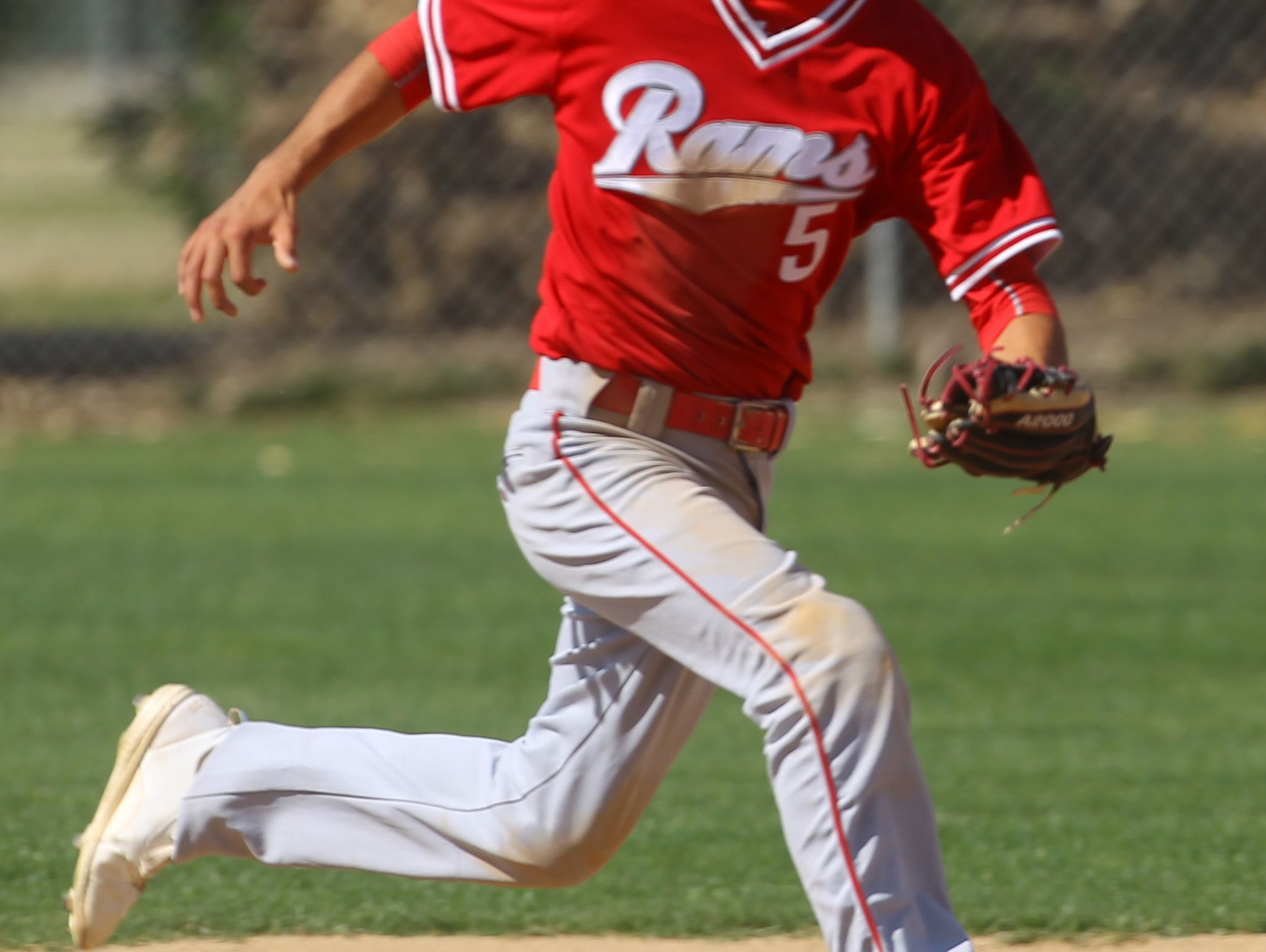 Desert Mirage High School's #5 runs down a ball hit by Coachella Valley High School during their game in Thermal.