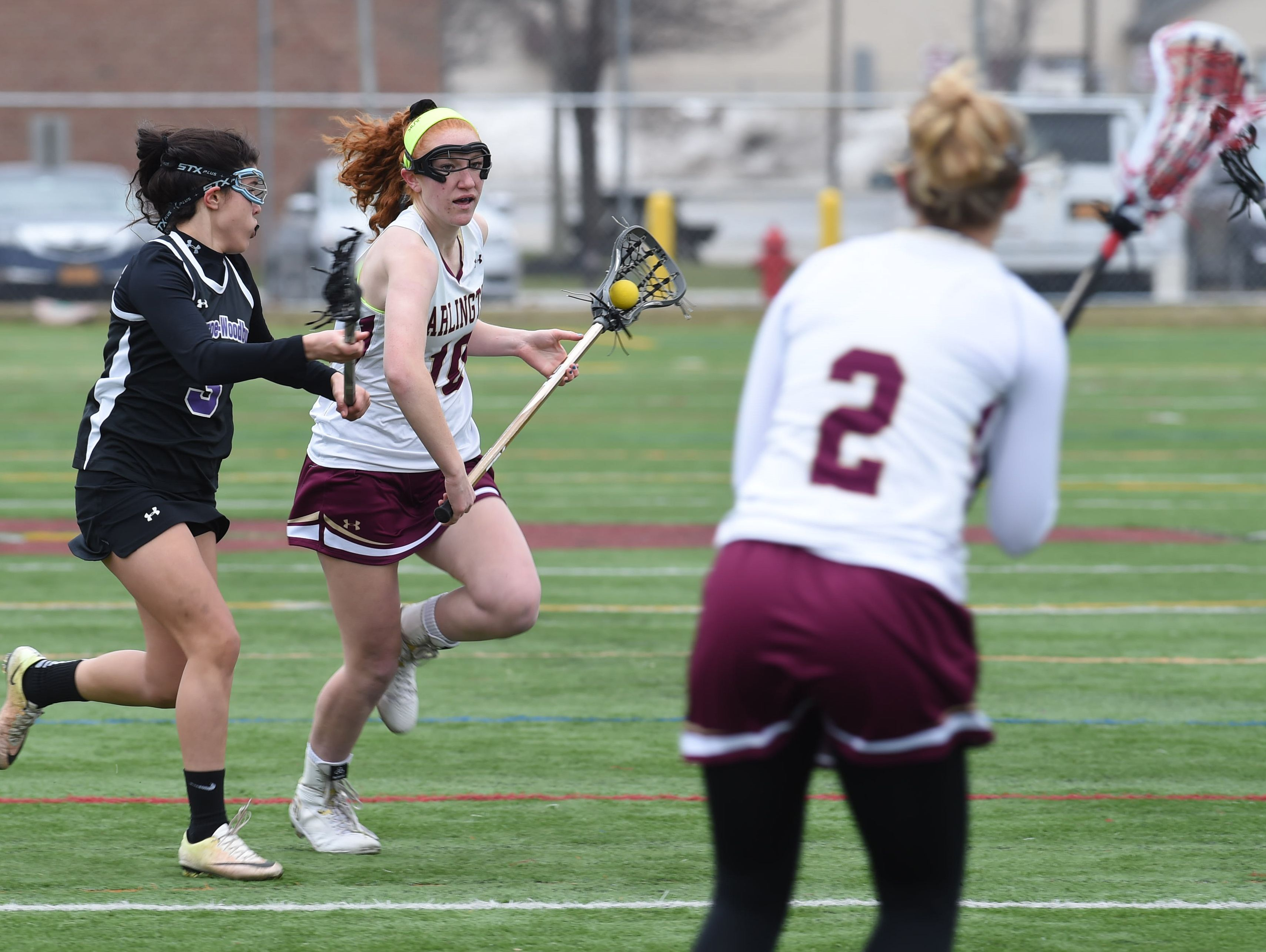 Arlington's Abby Carlin, center, takes the ball down the field during Saturday's game against Monroe-Woodbury.
