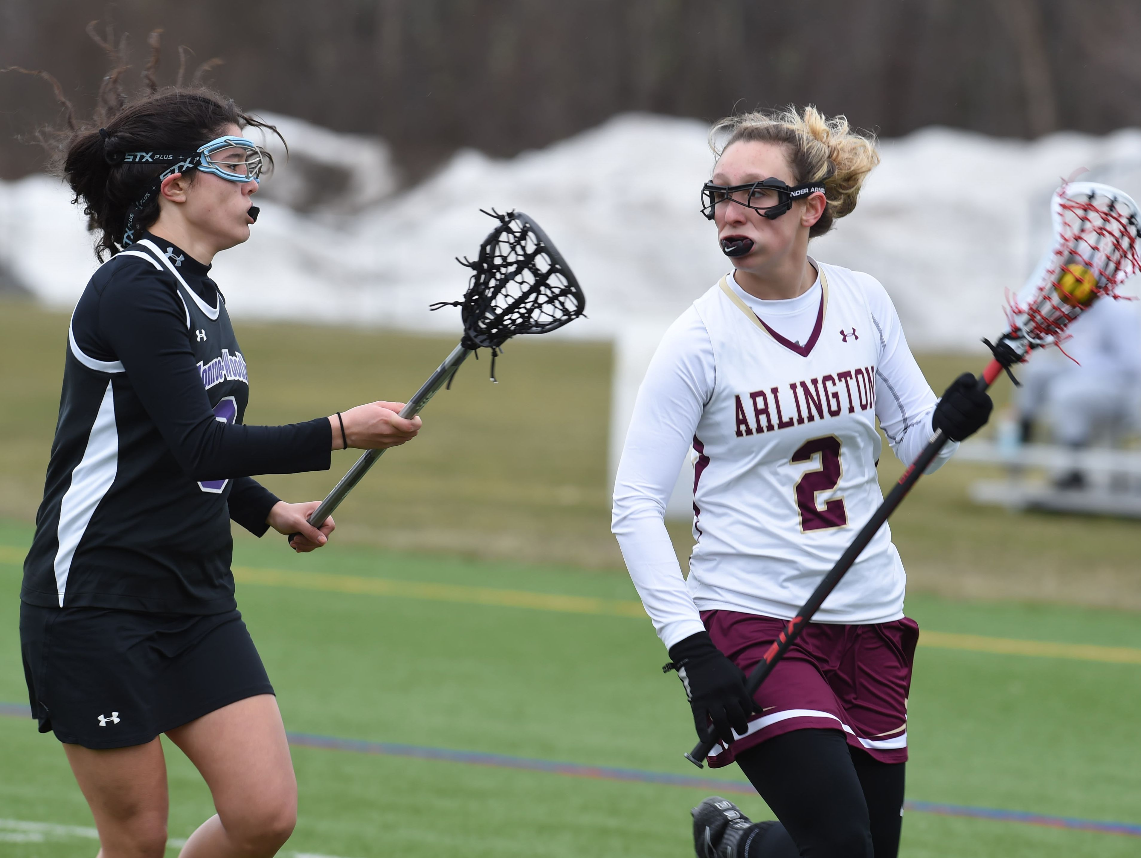 Arlington's Rosie Debellis, right, tries to get closer to the net during Saturday's game against Monroe-Woodbury.