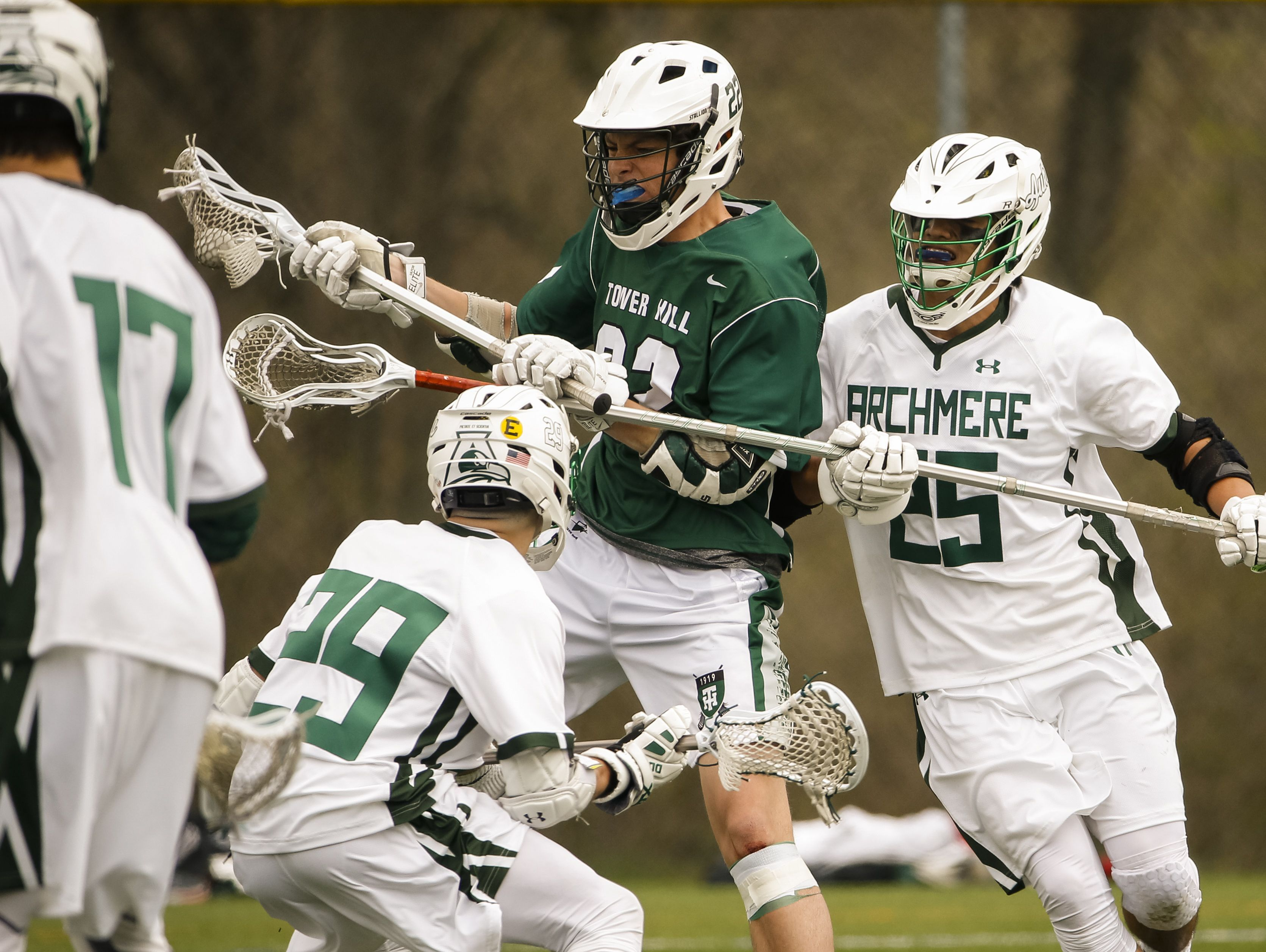 Tower Hill's William Corroon (center) works in his offensive zone in the second half of Archmere's 12-7 win Saturday. 22 25