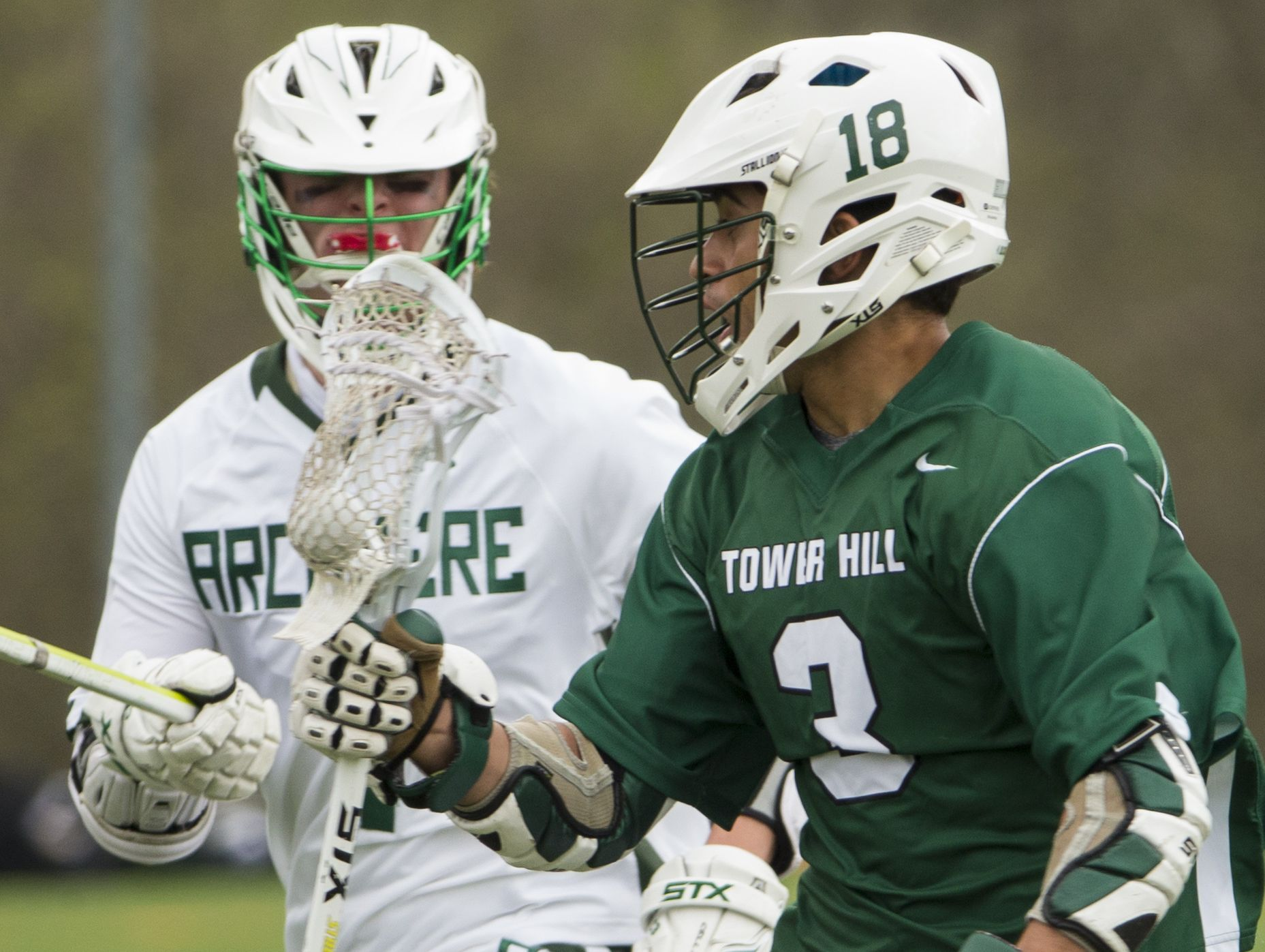 Archmere's Cole Bauer (left) eyes Tower Hill's Andrew Cercena in the second half of Archmere's 12-7 win Saturday.