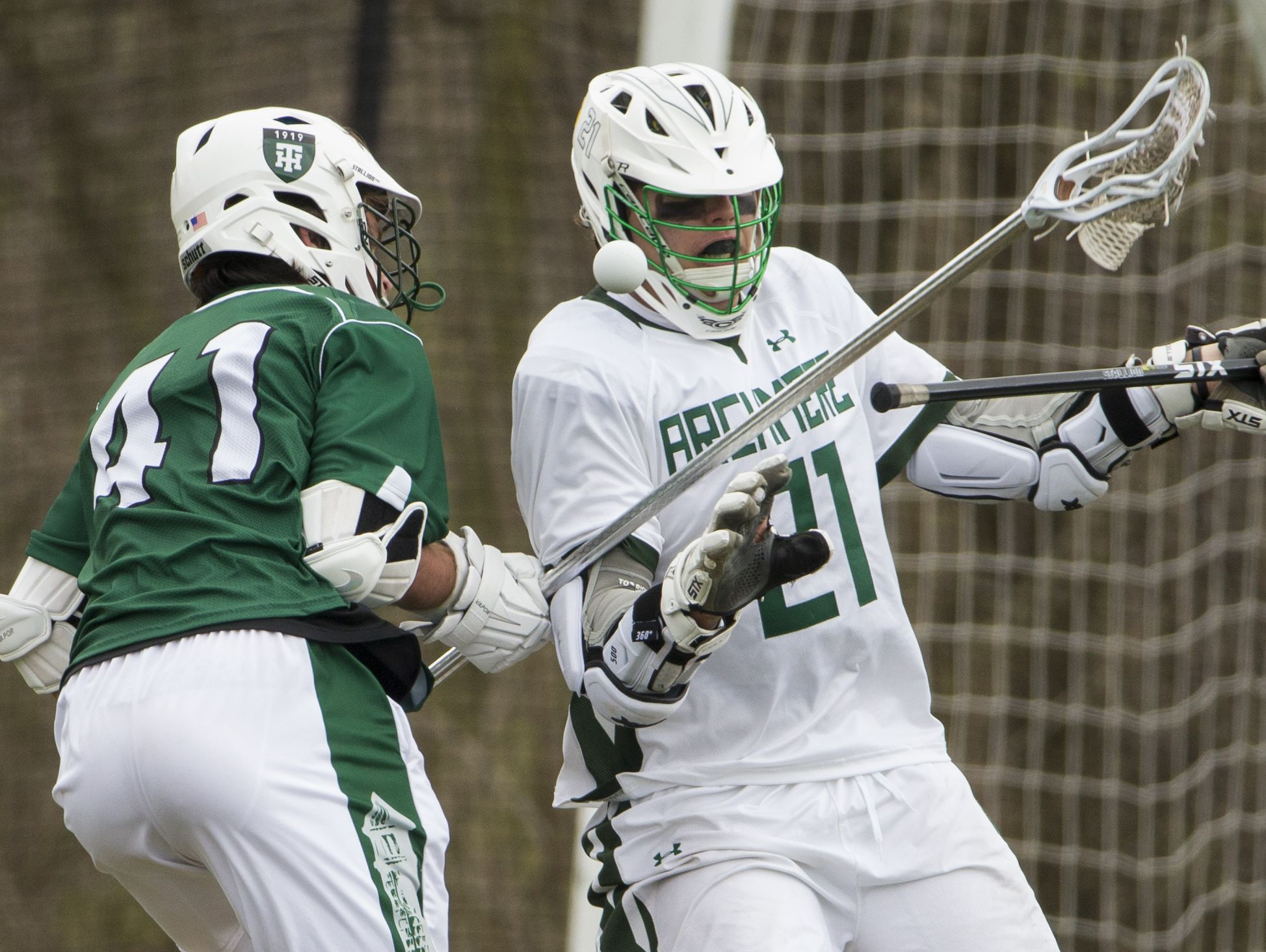 Tower Hill's Richard Corroon (left) gets the ball loose from Archmere's Mitchell Moyer in the second half of Archmere's 12-7 win Saturday.