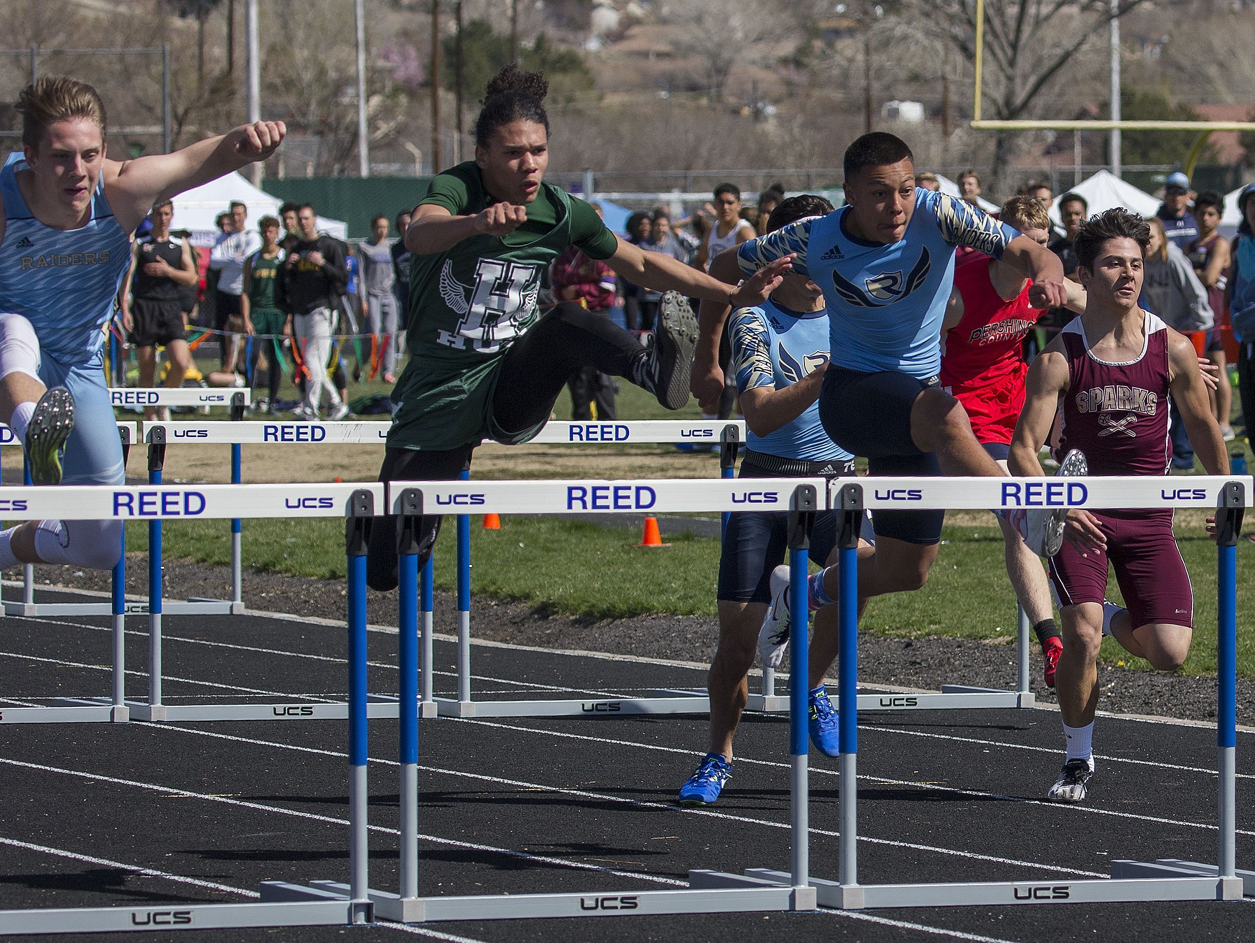 The boys 100-meter hurdles finals during the Reed Sparks Rotary Invitational track and field event at Reed on Saturday.
