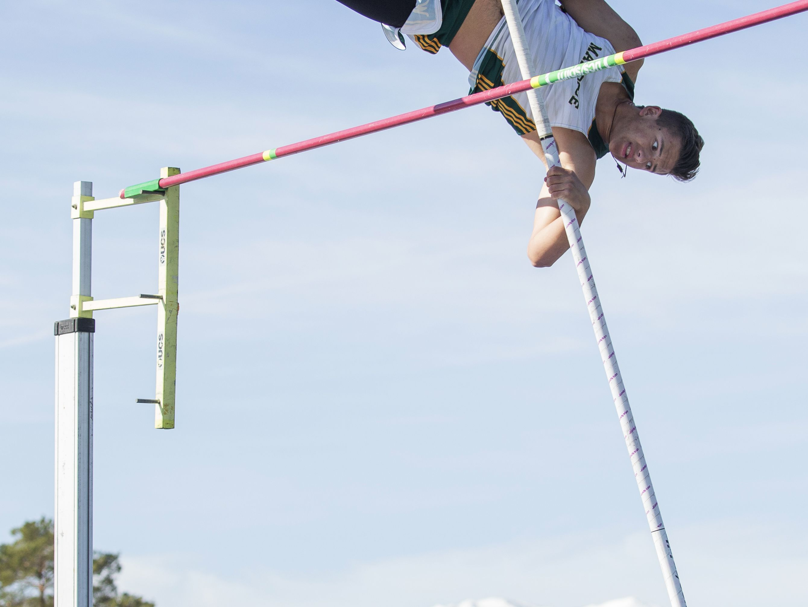 Bishop Manogue's Max Crow competes in the boys pole vault during the Reed Sparks Rotary Invitational track and field event at Reed on Saturday.