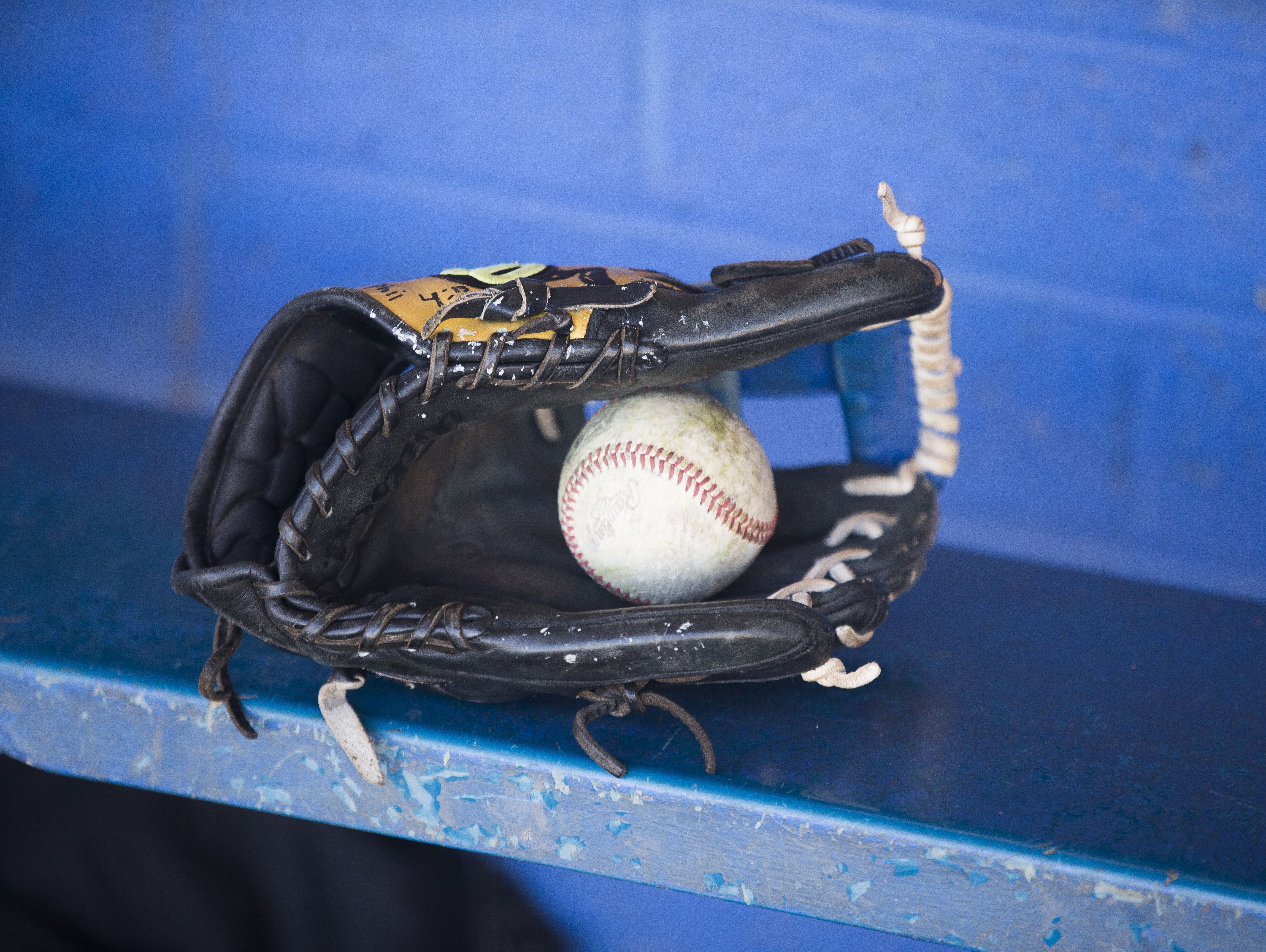 A glove sits on the bench before baseball practice at Prescott High School on March 24, 2017 in Prescott, Ariz.