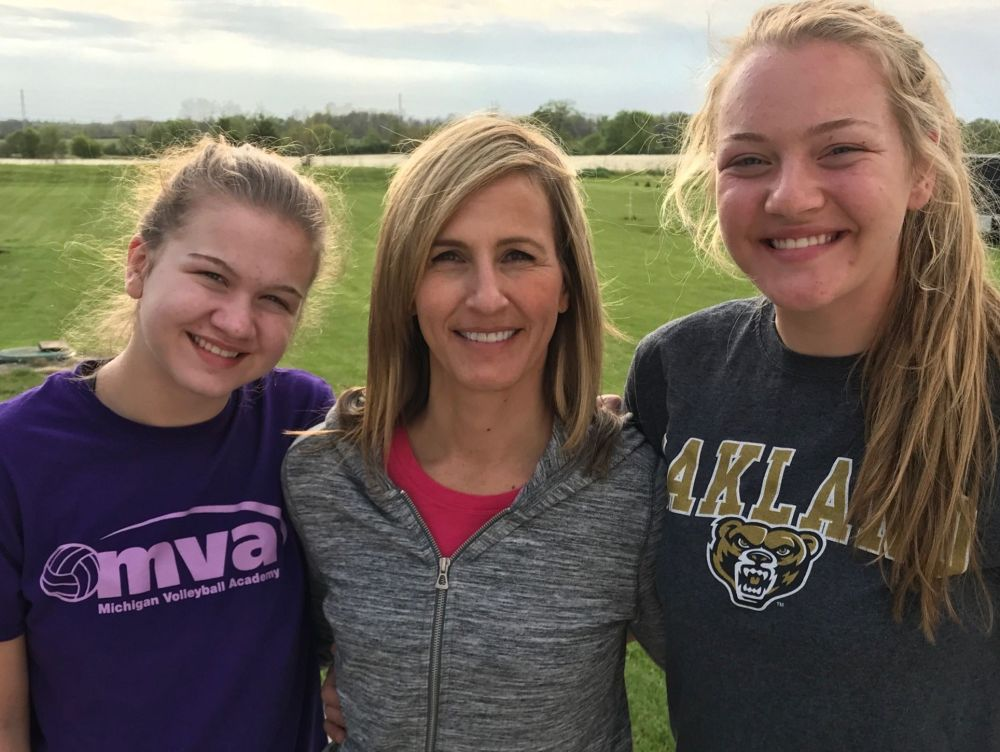 Amy Kissman with her daughters Sage (left) and Autumn (right).