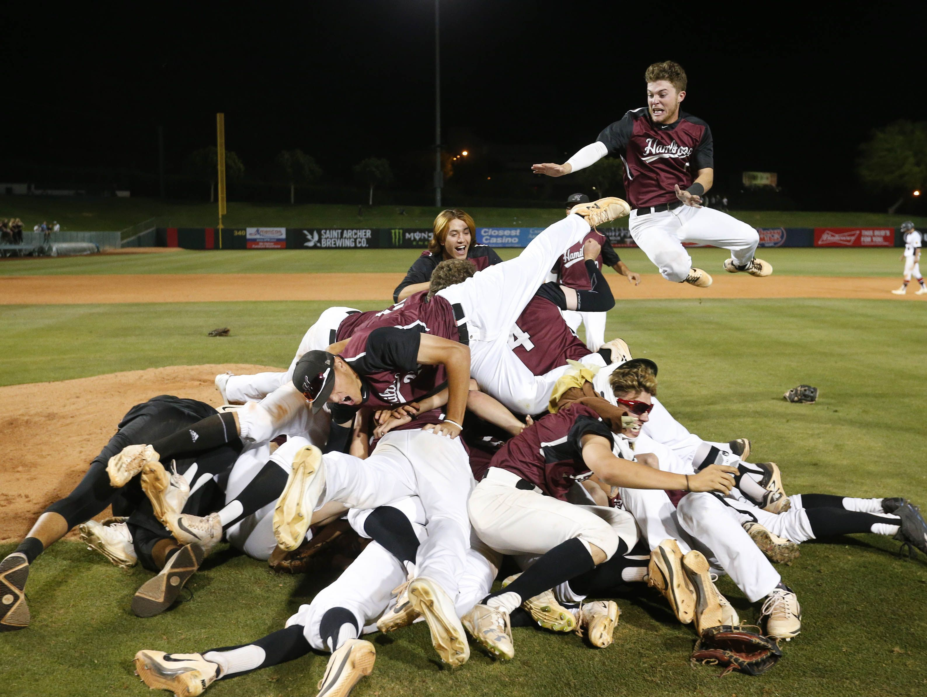 Hamilton players celebrate after beating Pinnacle 6-4 to win the 6A high school baseball state championship in Tempe, Ariz. May 16, 2017.