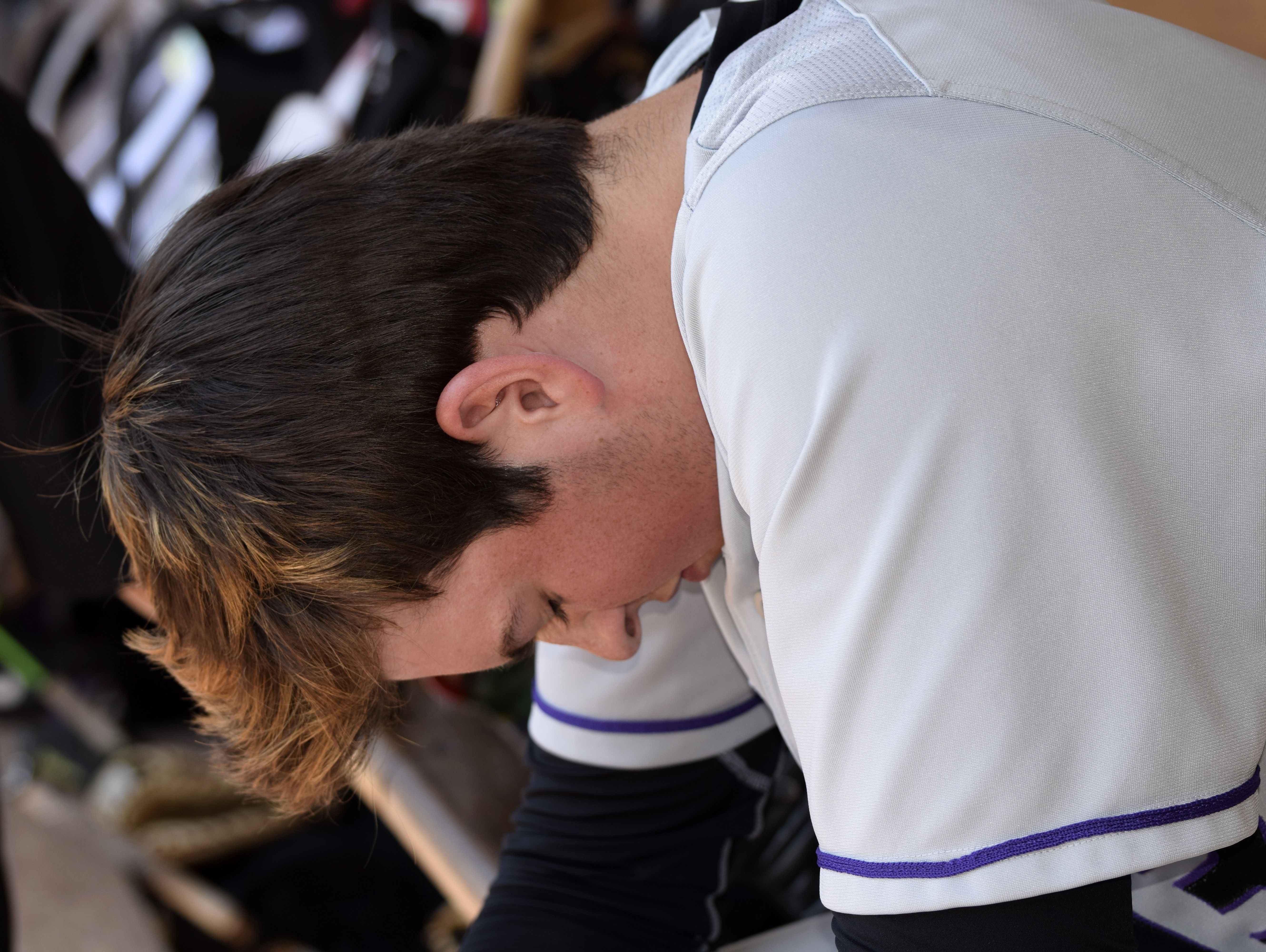 CHCA pitcher Griffan Smith takes a moment for quiet prayer before taking mound.