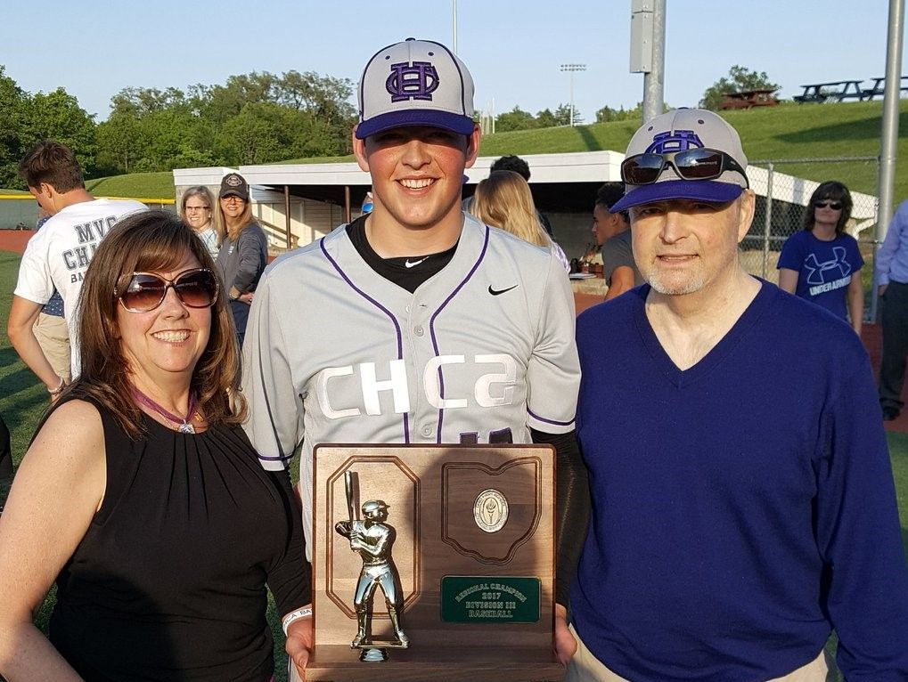 CHCA senior Griffan Smith with his mom, Joyce, and his dad, Alan, after the Eagles won their third regional baseball championship in school history on May 26.