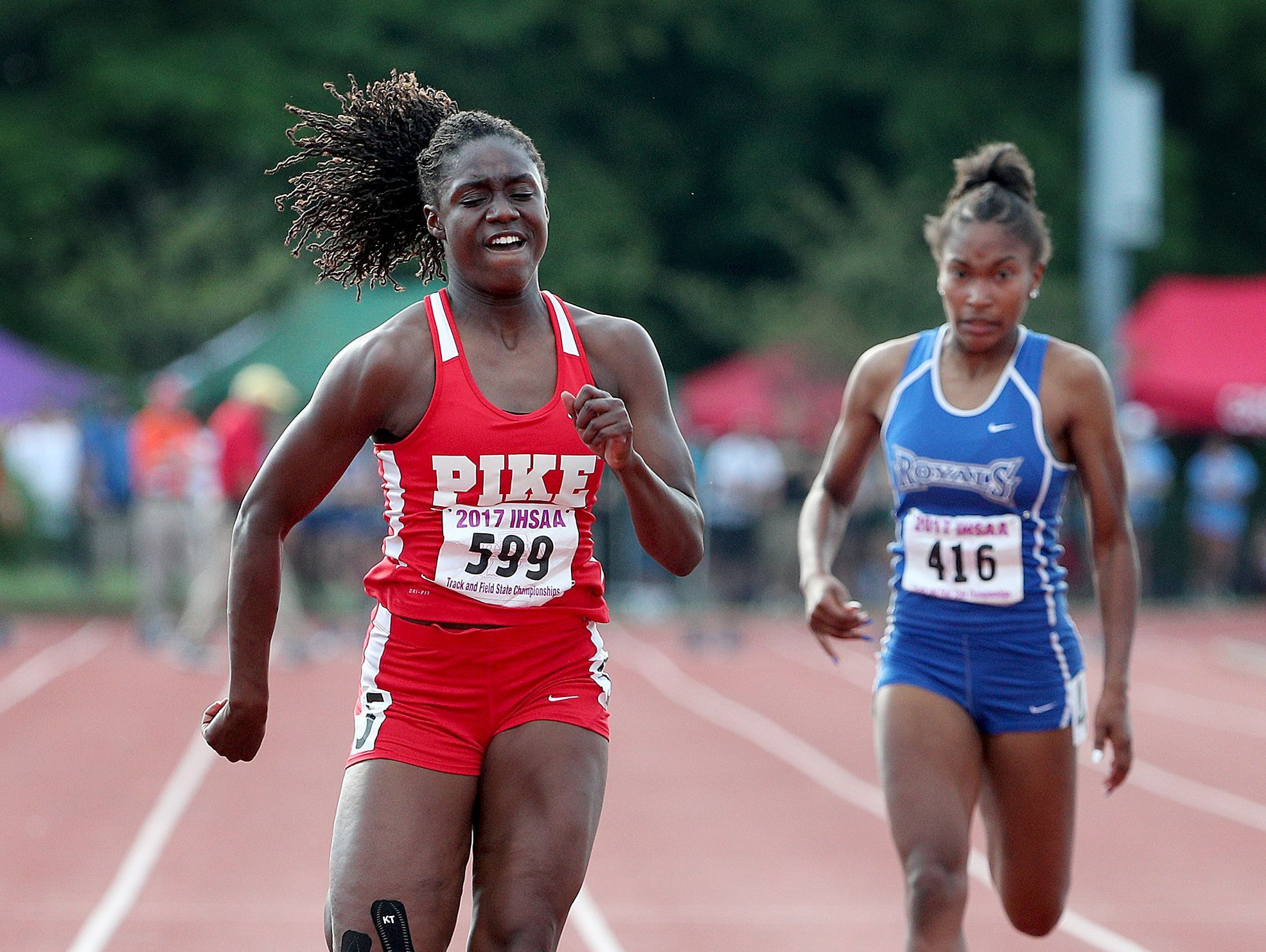 Pike's Lynna Irby finishes in first place in the 100 meter dash during the girls IHSAA State Finals at Indiana University's Robert C. Haugh Track & Field Complex in Bloomington, Saturday.