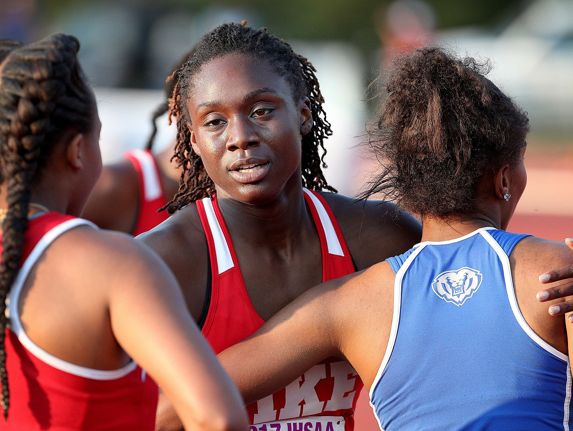 Pike's Lynna Irby hugs her competitors following the Girls 200 Meter dash.