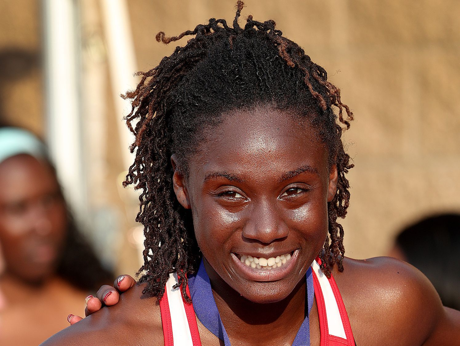 Pike's Lynna Irby smiles for the camera on the podium following the Girls 400 Meter dash.