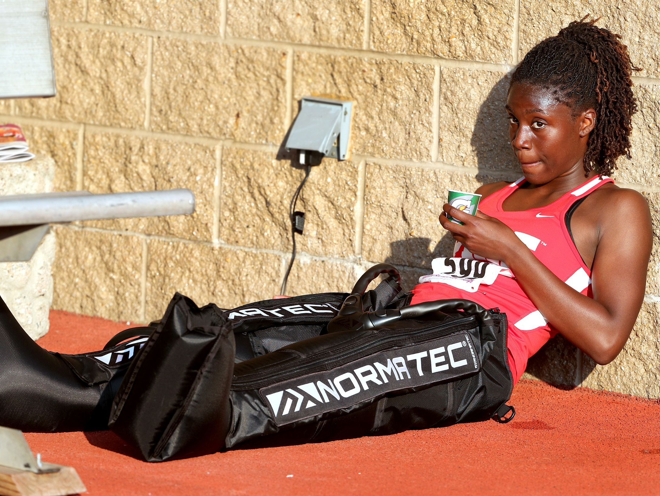 Pike's Lynna Irby gets treatment on her legs between races during the girls IHSAA State Finals at Indiana University's Robert C. Haugh Track & Field Complex in Bloomington, Saturday, June 3, 2017.