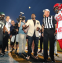 LaDainian Tomlinson flips the opening coin toss before the first ever Peanut Bowl (Richard Rodriguez/National Peanut Board/Associated Press)