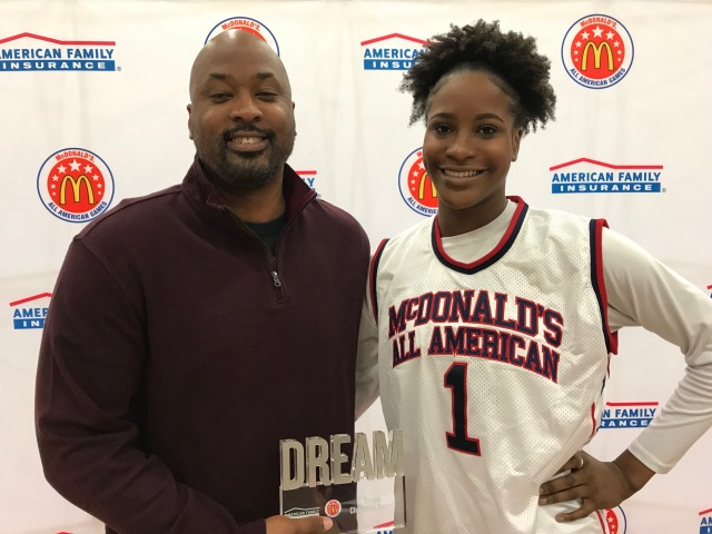Queen Egbo presents her father with her Dream Award (Photo: McDonald's All-American Games)