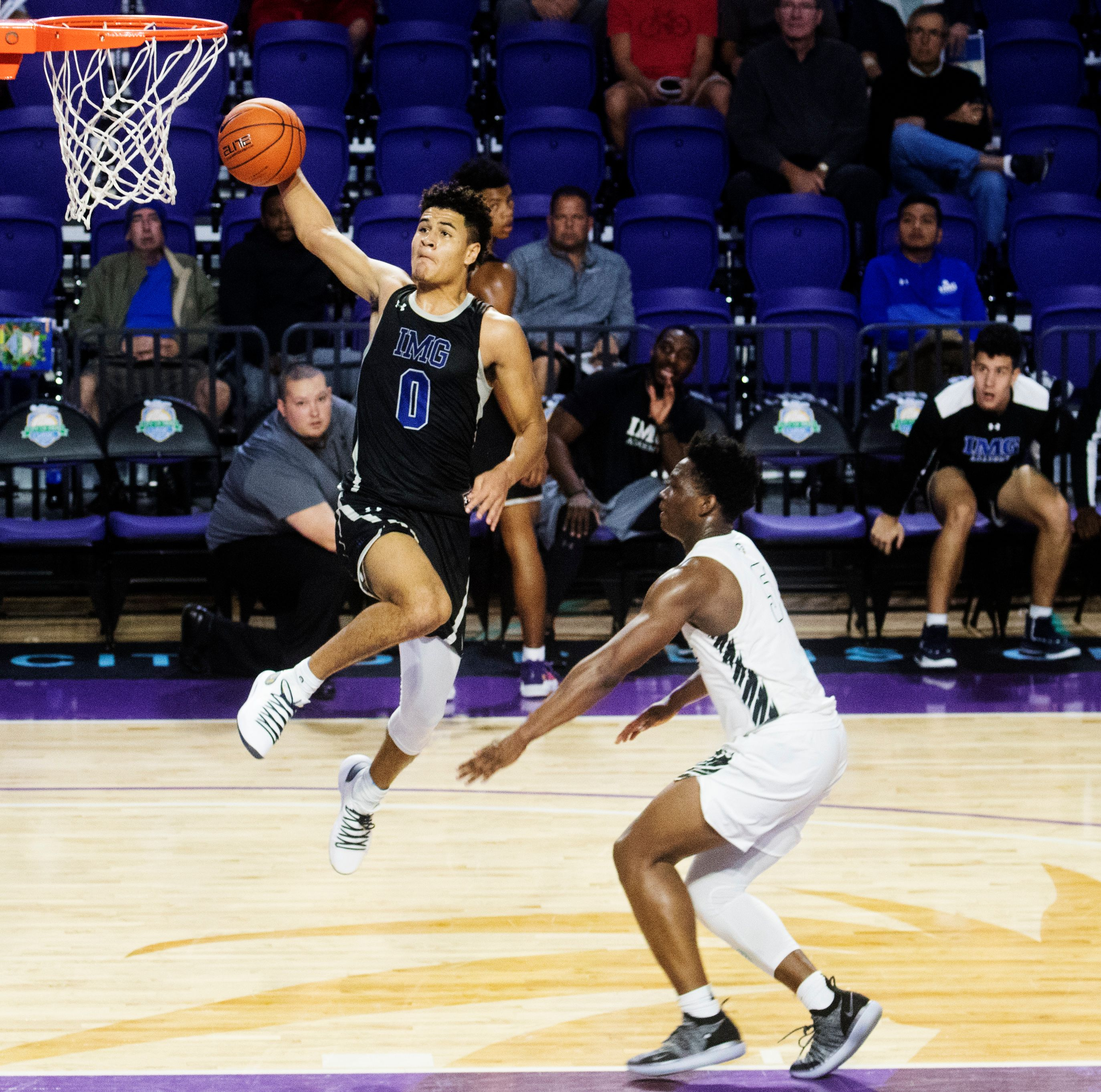IMG's Josh Green scores against Gray Collegiate in the City of Palms Classic first round game at Suncoast Credit Union Arena on Tuesday. Green led all scorers with 22 points as IMG won 82-68. Photo: Andrew West/The News-Press